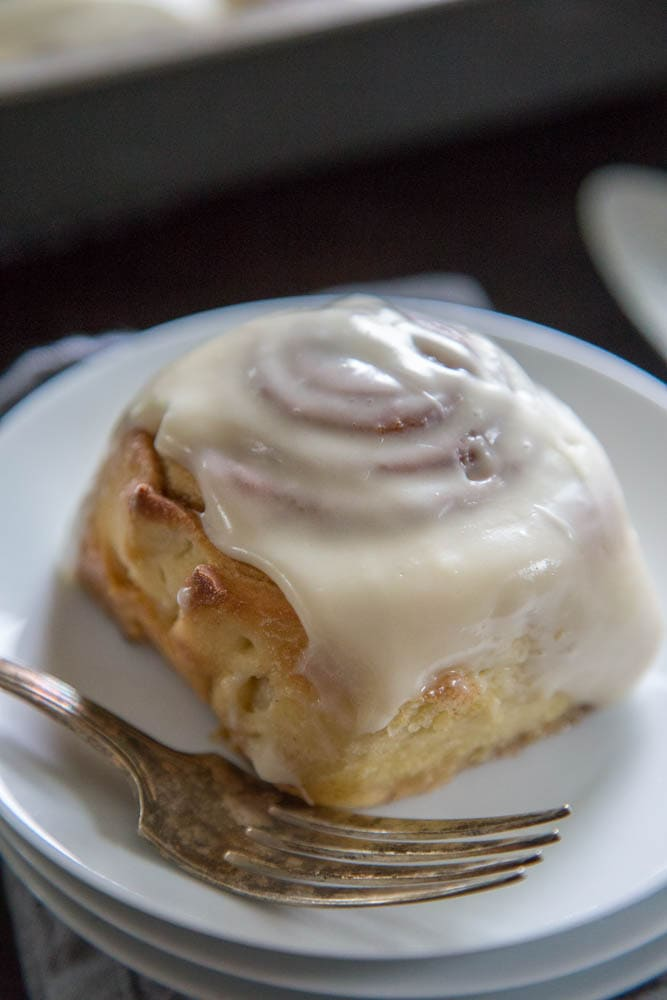 photo of a cinnamon roll on a plate