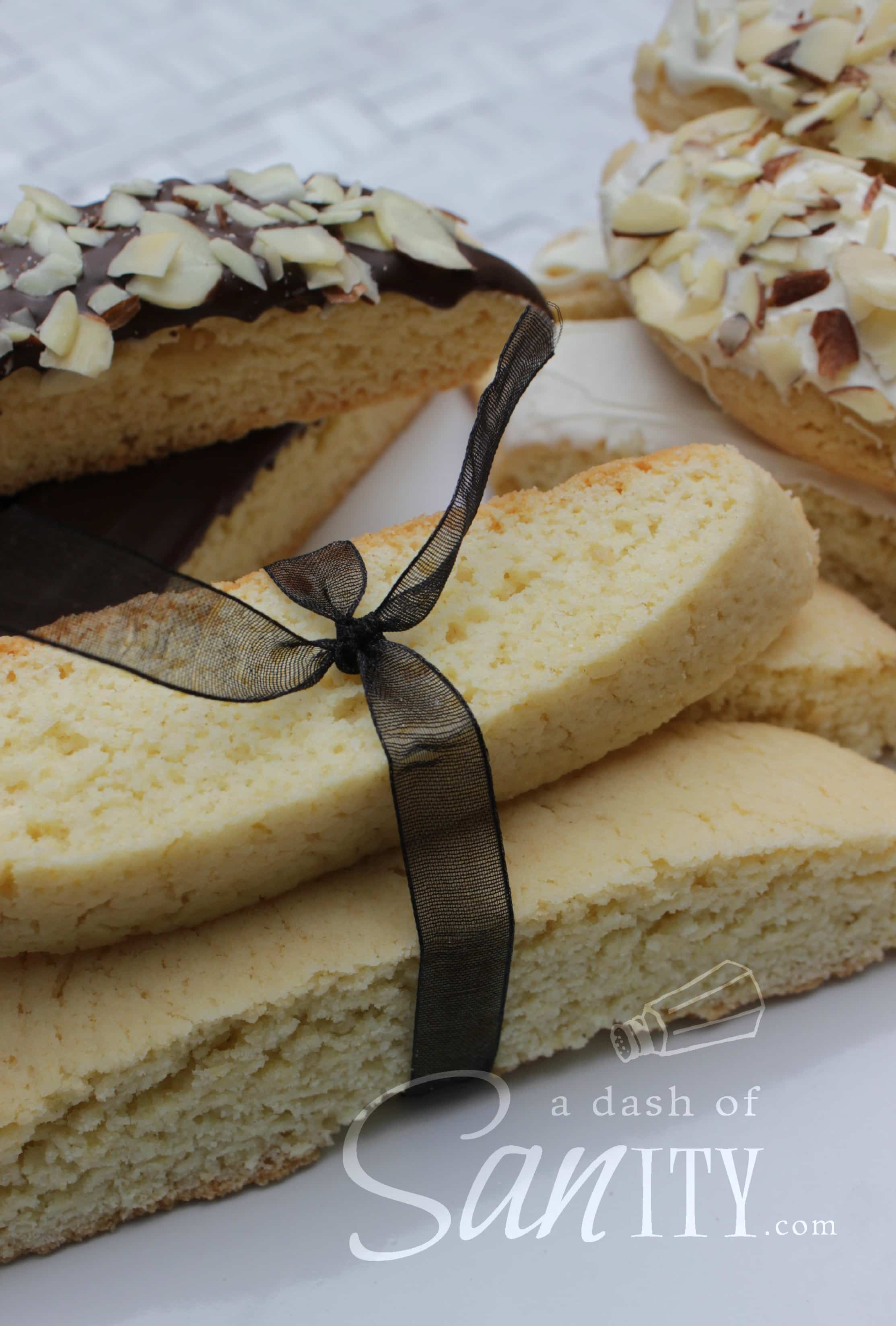 Italian Almond Biscotti in a bunch tied with a ribbon, next to chocolate dipped biscotti
