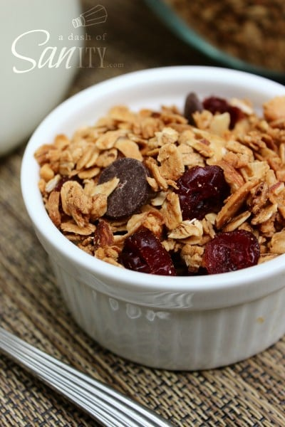 cinnamon maple granola with cranberries in a small white bowl