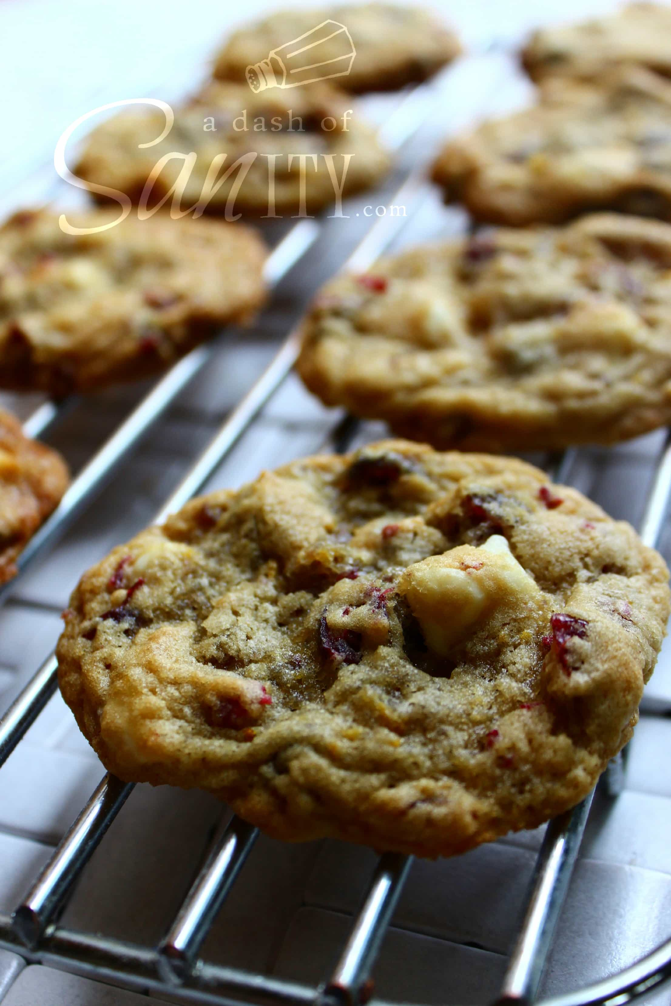 Cranberry-Orange White Chocolate & Macadamia Nut Cookies on a wire rack