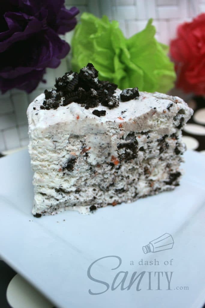 Oreo Ice Cream Cake slice on a square plate topped with crumbled oreos