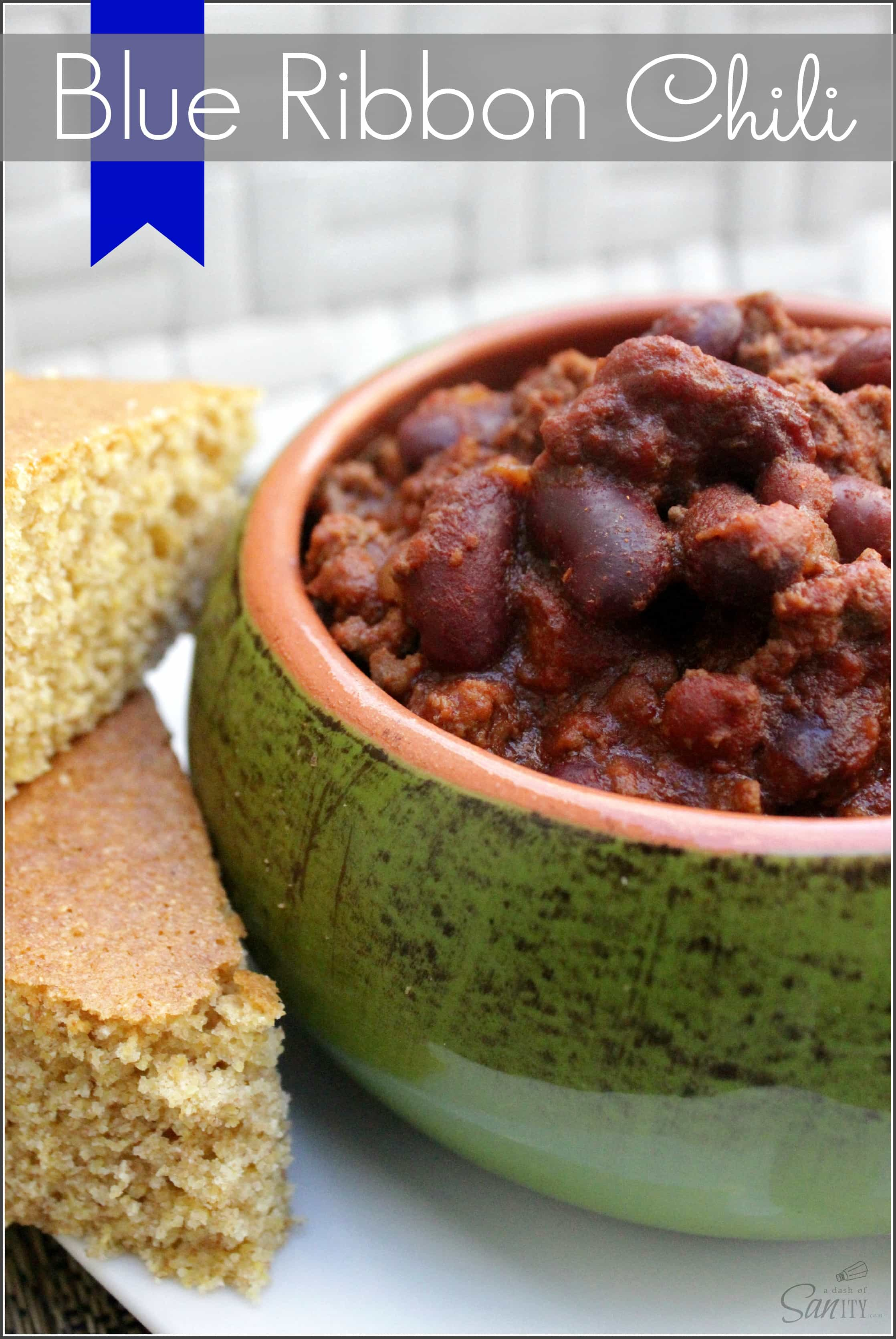 Blue Ribbon Chili in a bowl on a plate with cornbread slices