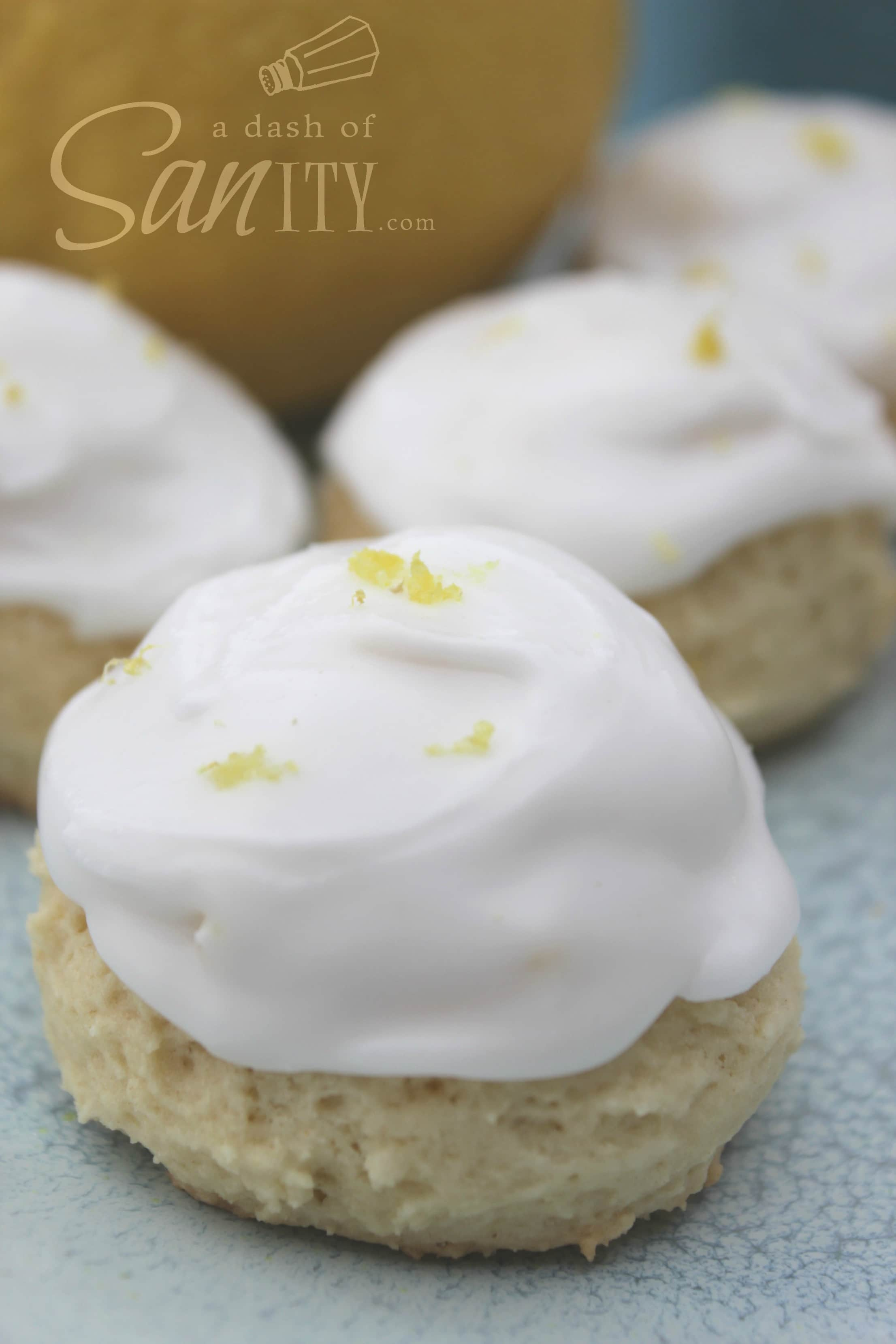 Anginetti - Italian Lemon Drop Cookies up close with icing and lemon zest on top