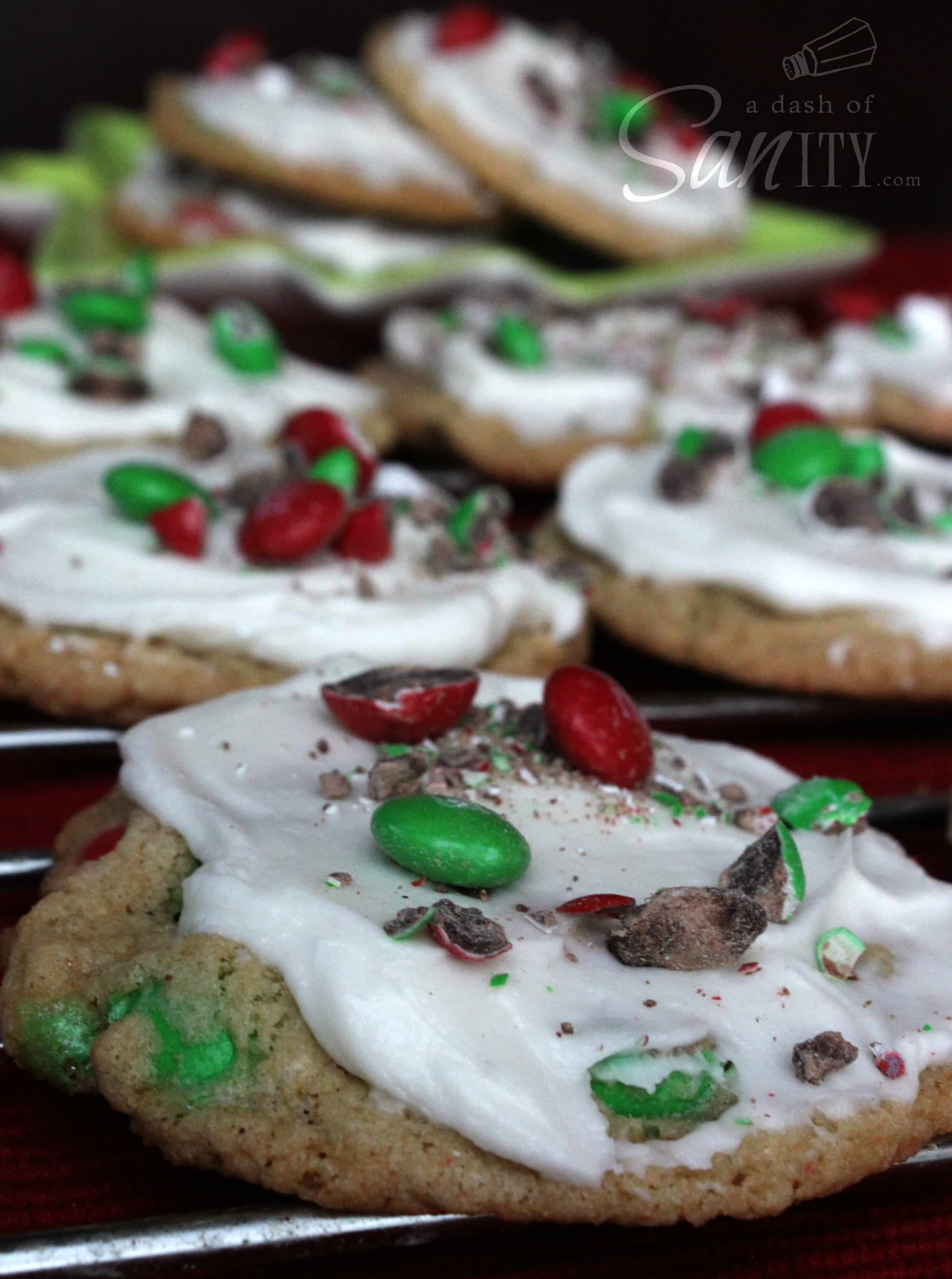 Frosted Mint M&M Cookies on a metal cooling rack