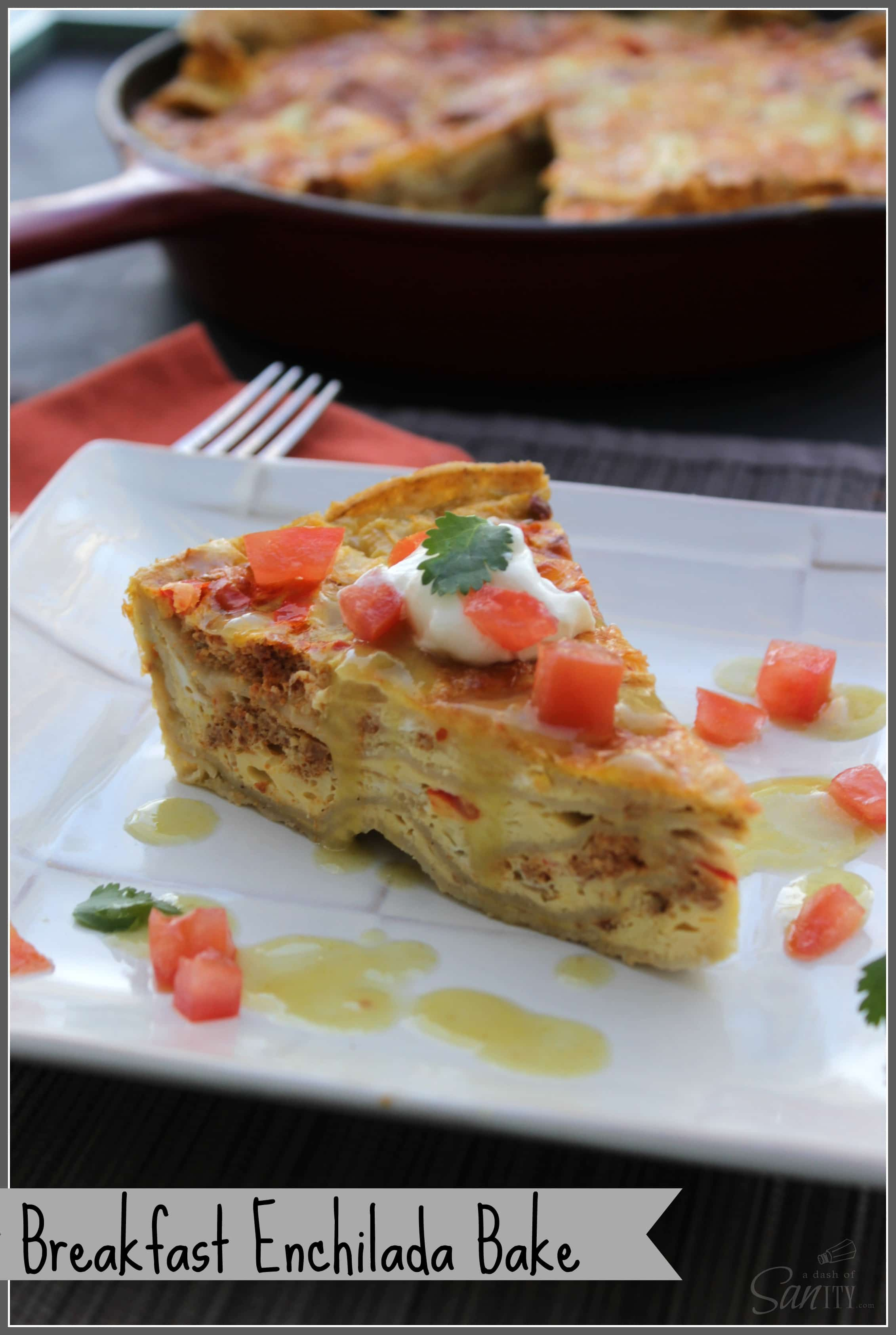 Breakfast Enchilada Bake slice served on a square plate, with cast iron skillet in background