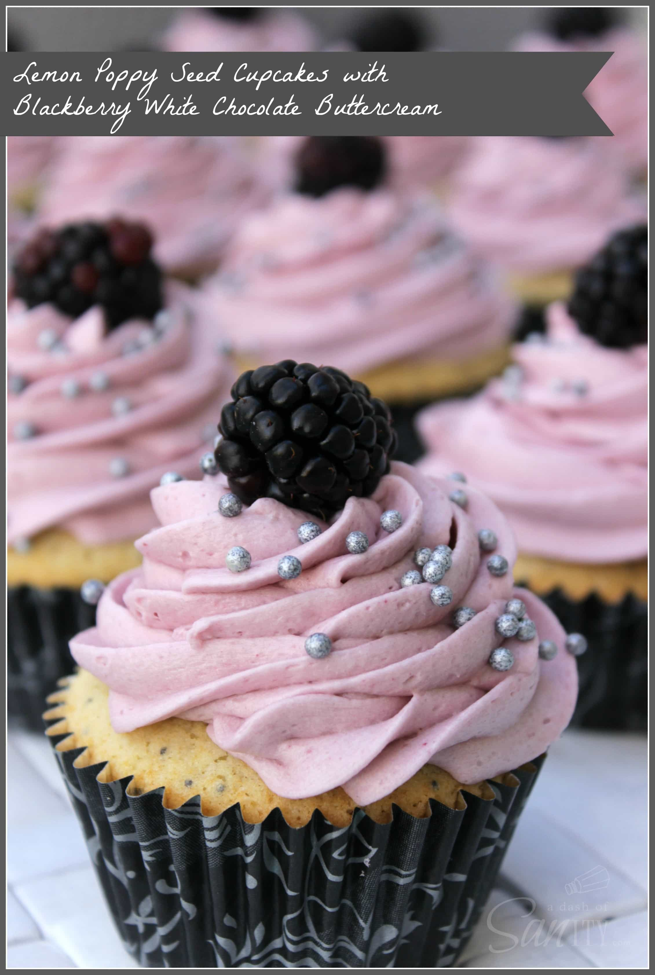 Lemon-Poppy Seed Cupcake with Blackberry White Chocolate Buttercream piped, with a blackberry and silver round sprinkles