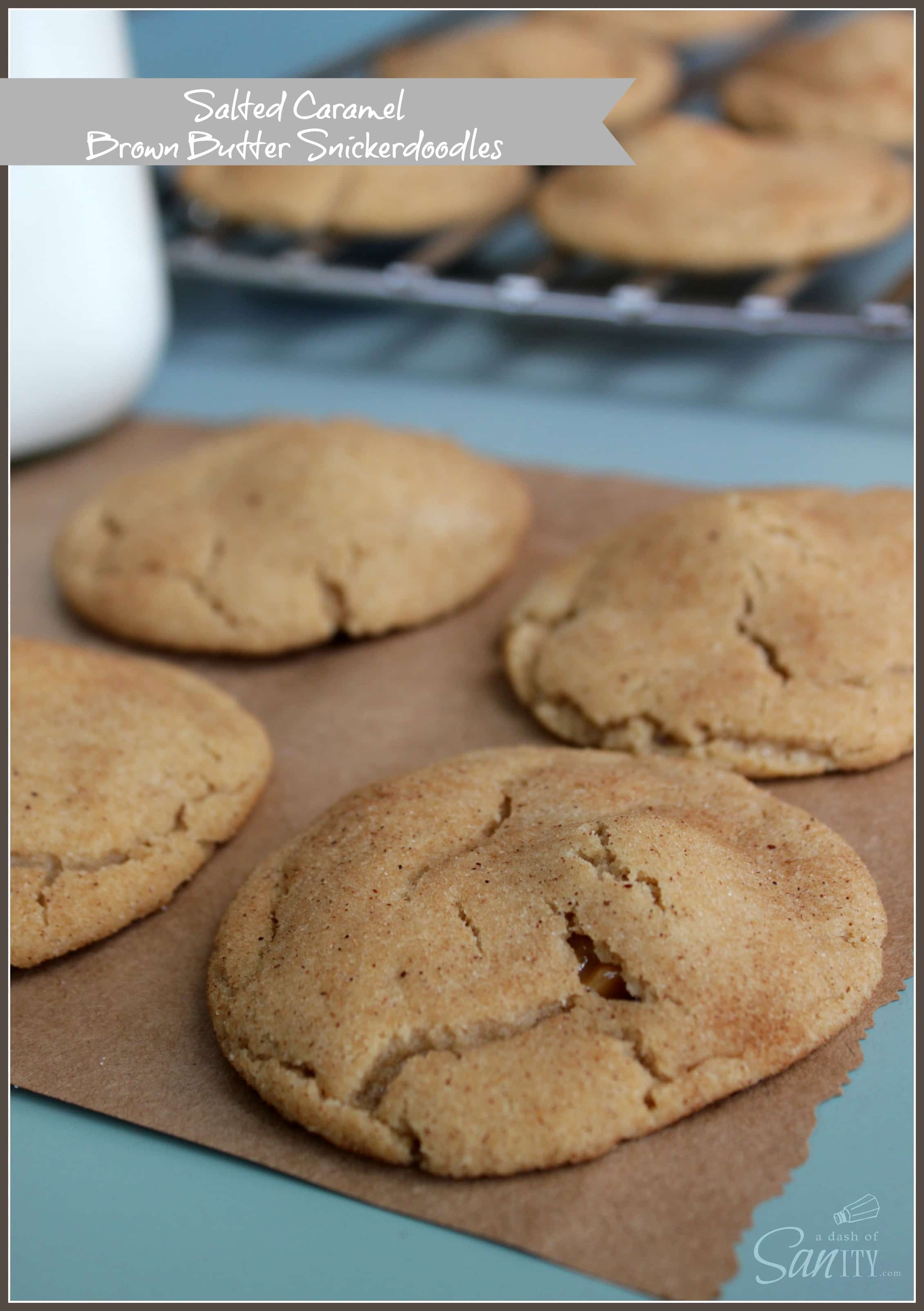 Salted Caramel & Brown Butter Snickerdoodles on a piece of brown paper and cooling rack