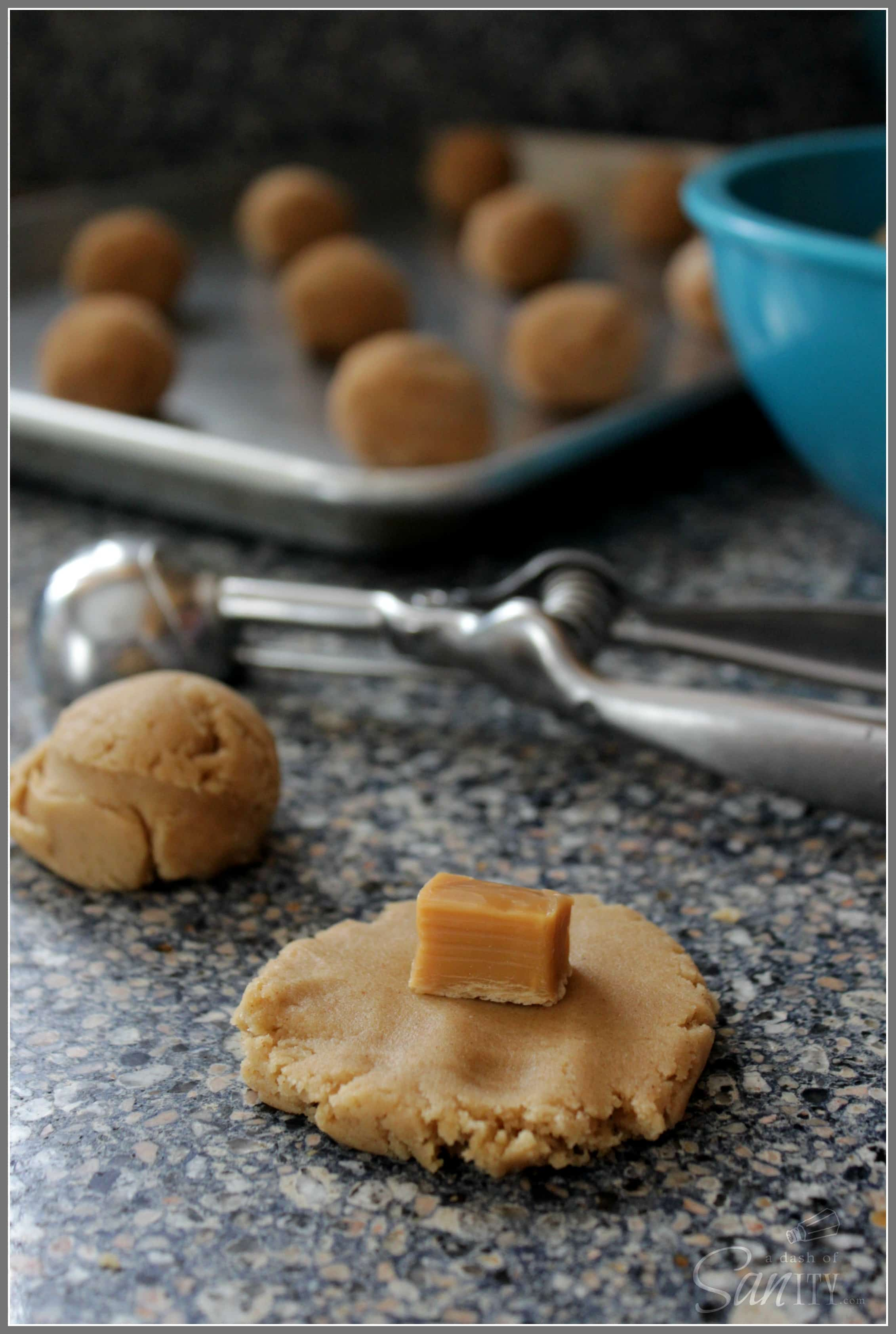 Salted Caramel & Brown Butter Snickerdoodles are addictive cookies with a gooey caramel center, a dash of sea salt, and garnished with cinnamon sugar.