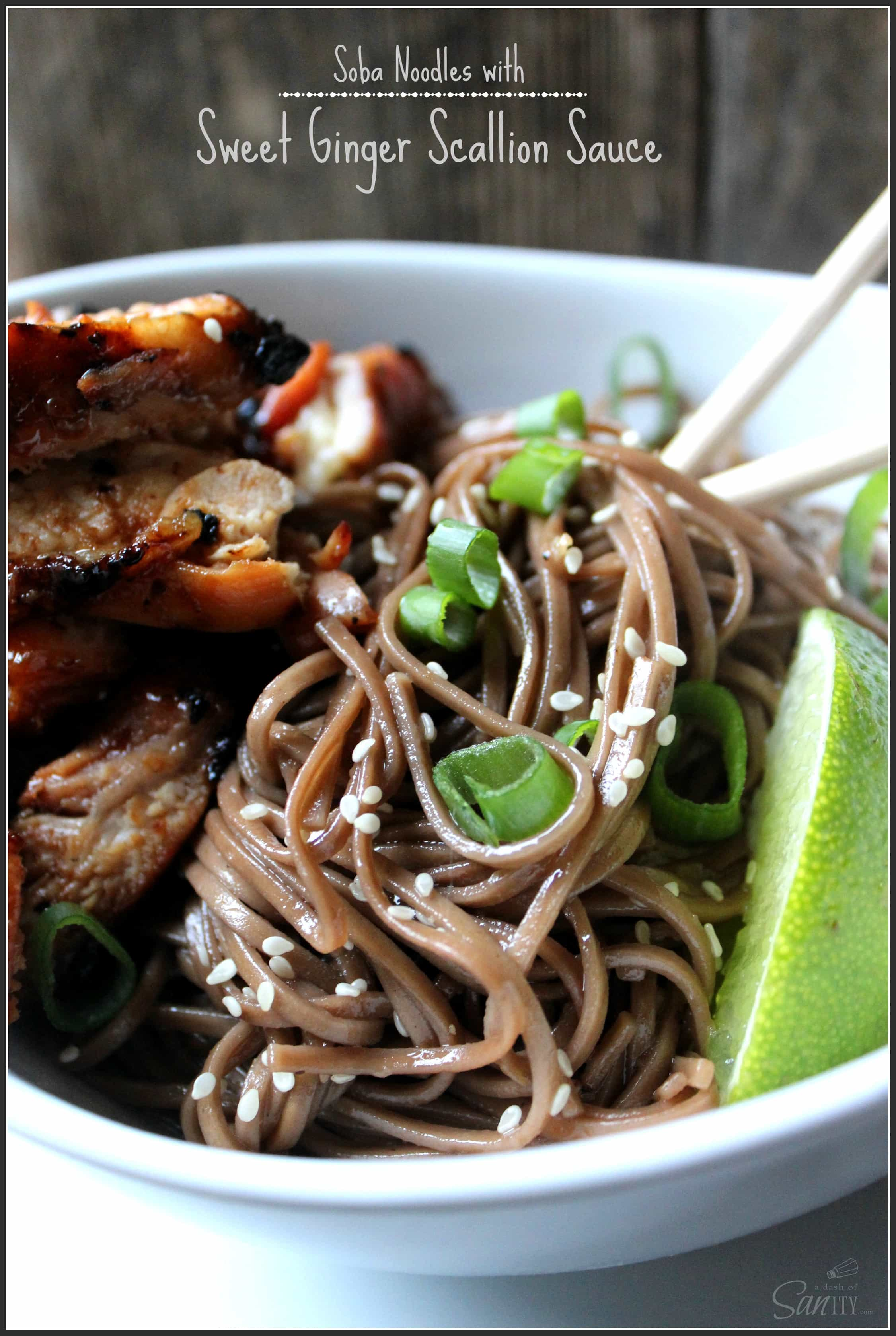 Soba Noodles with Sweet Ginger Scallion Sauce served with chopsticks and a lime slice in a bowl
