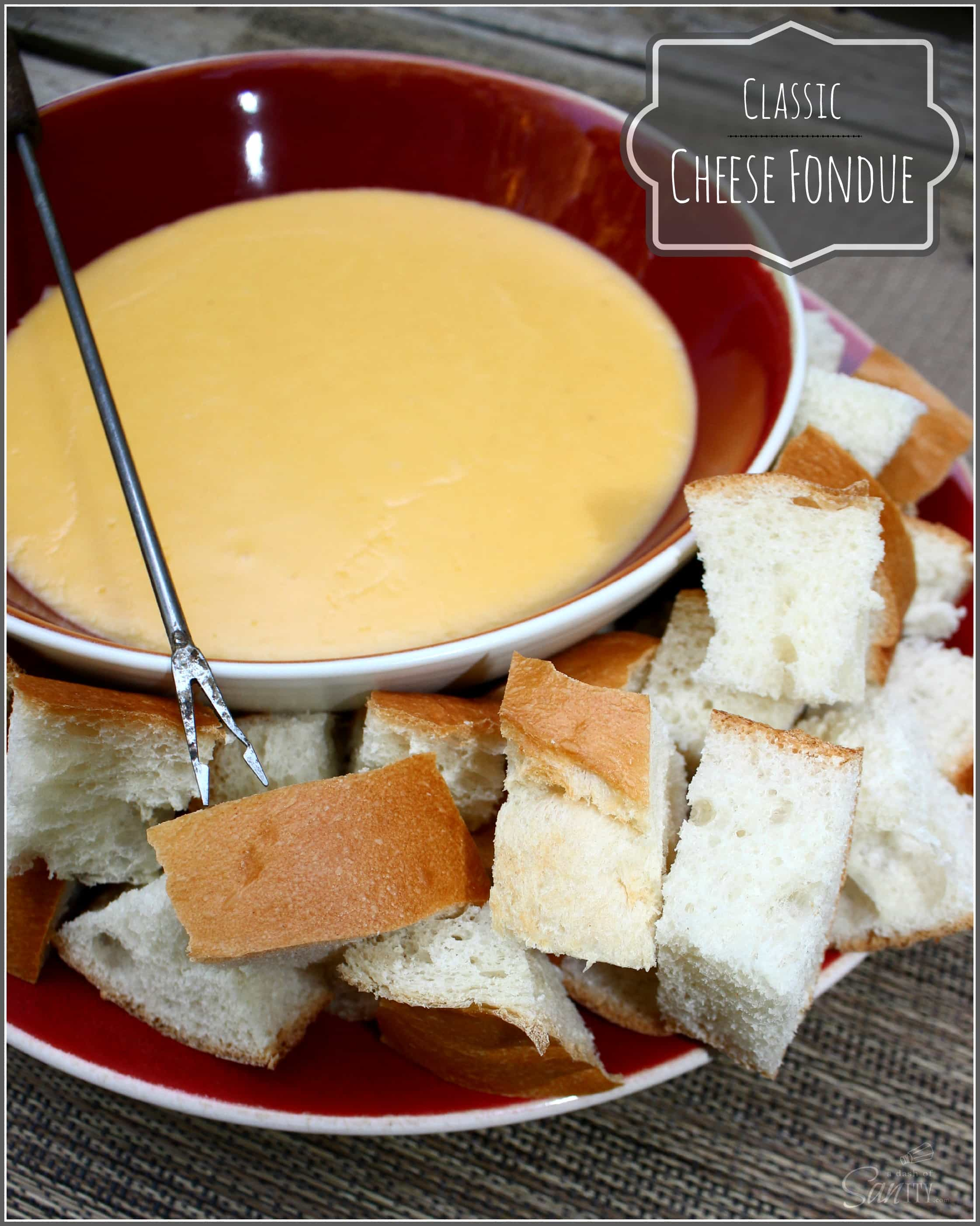 Cheese Fondue in a bowl served on a plate of bread cubes, with a fondue fork