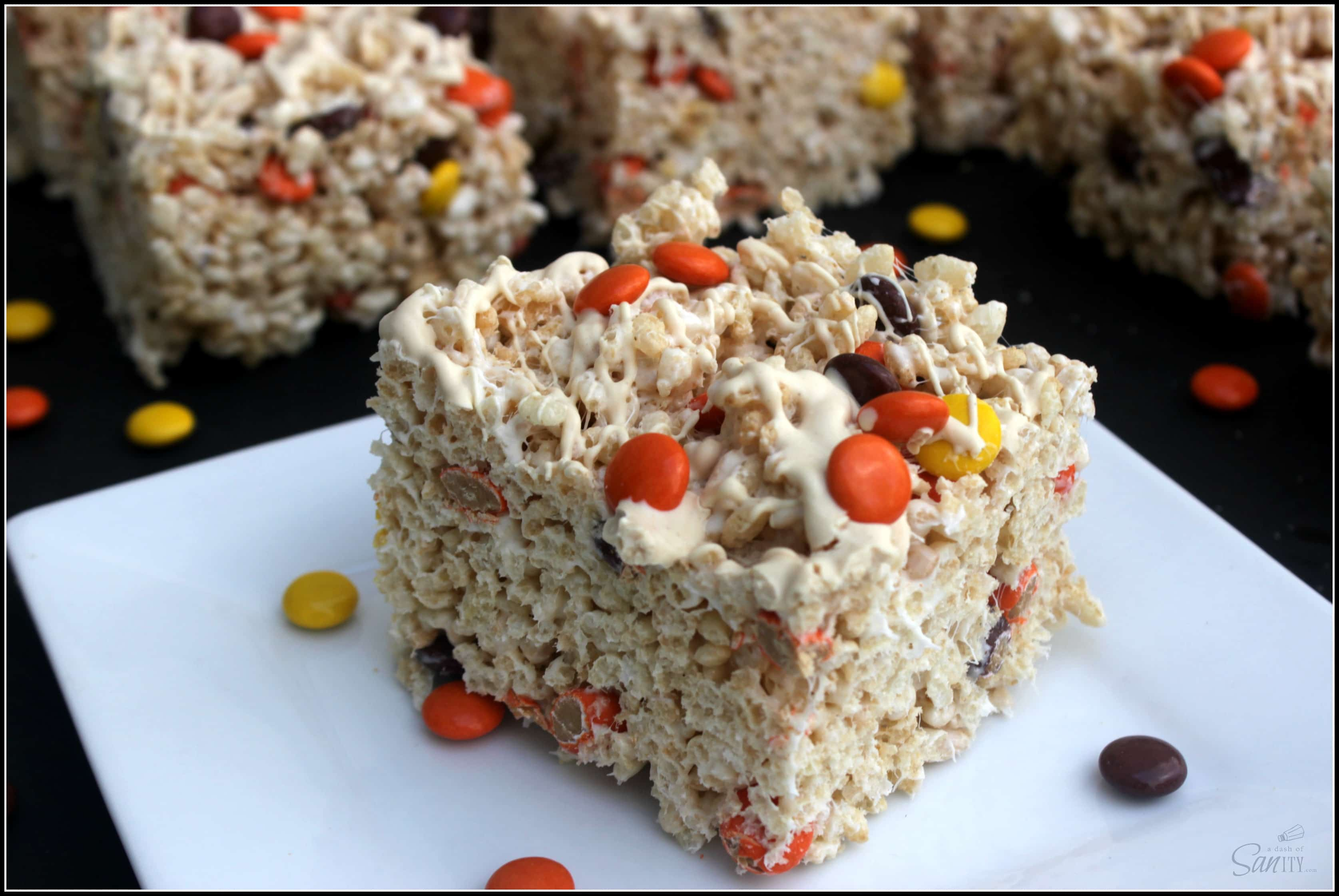 White Chocolate Reese's Pieces Rice Krispies Treats - white chocolate, Reese's Pieces, and a gooey marshmallow treat melded into one of the finest snacks.