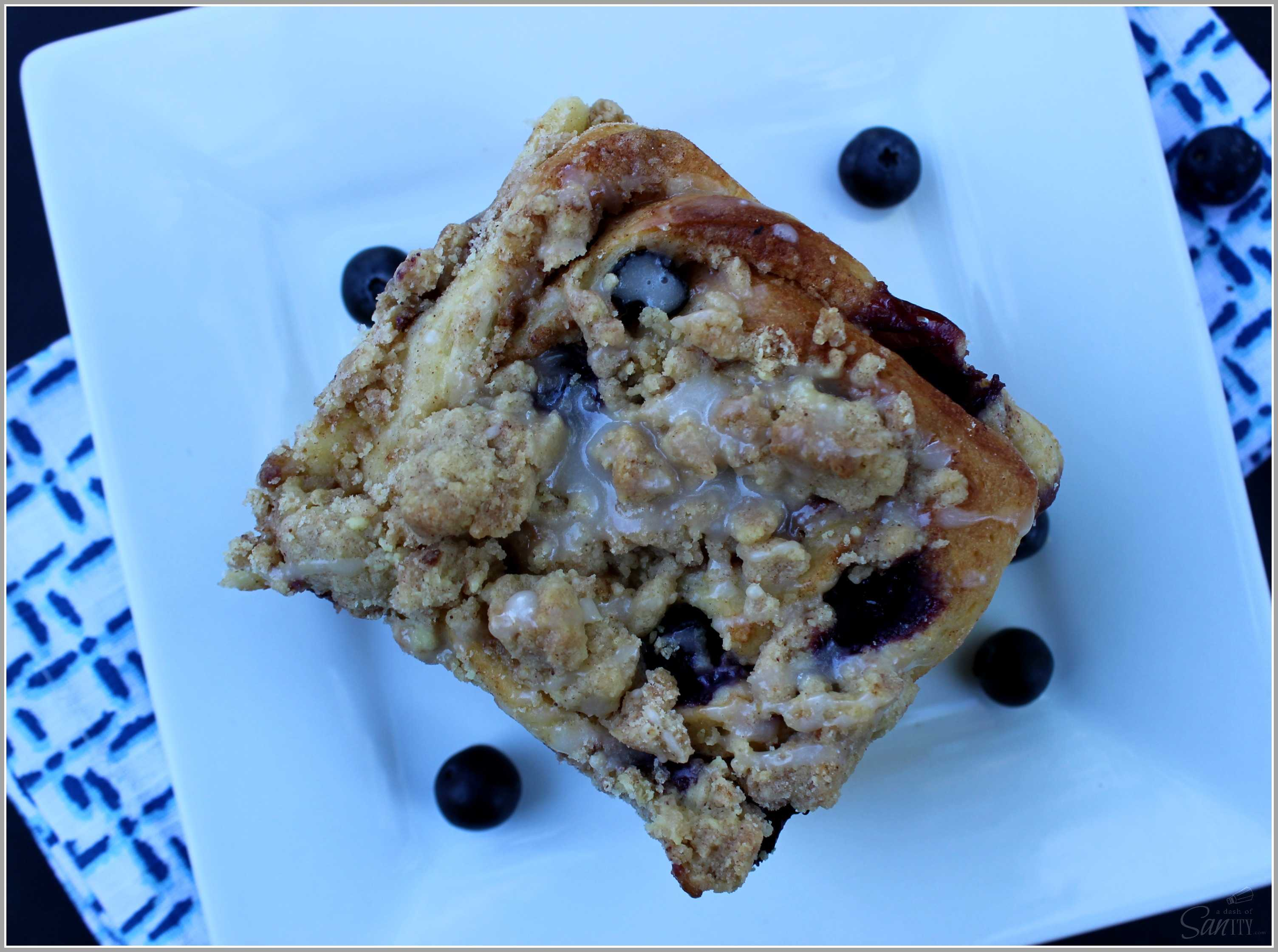 Blueberry Crumb Sweet Rolls with fresh blueberries & a creamy cinnamon center, then topped with a crumb topping, marrying two morning favorites.