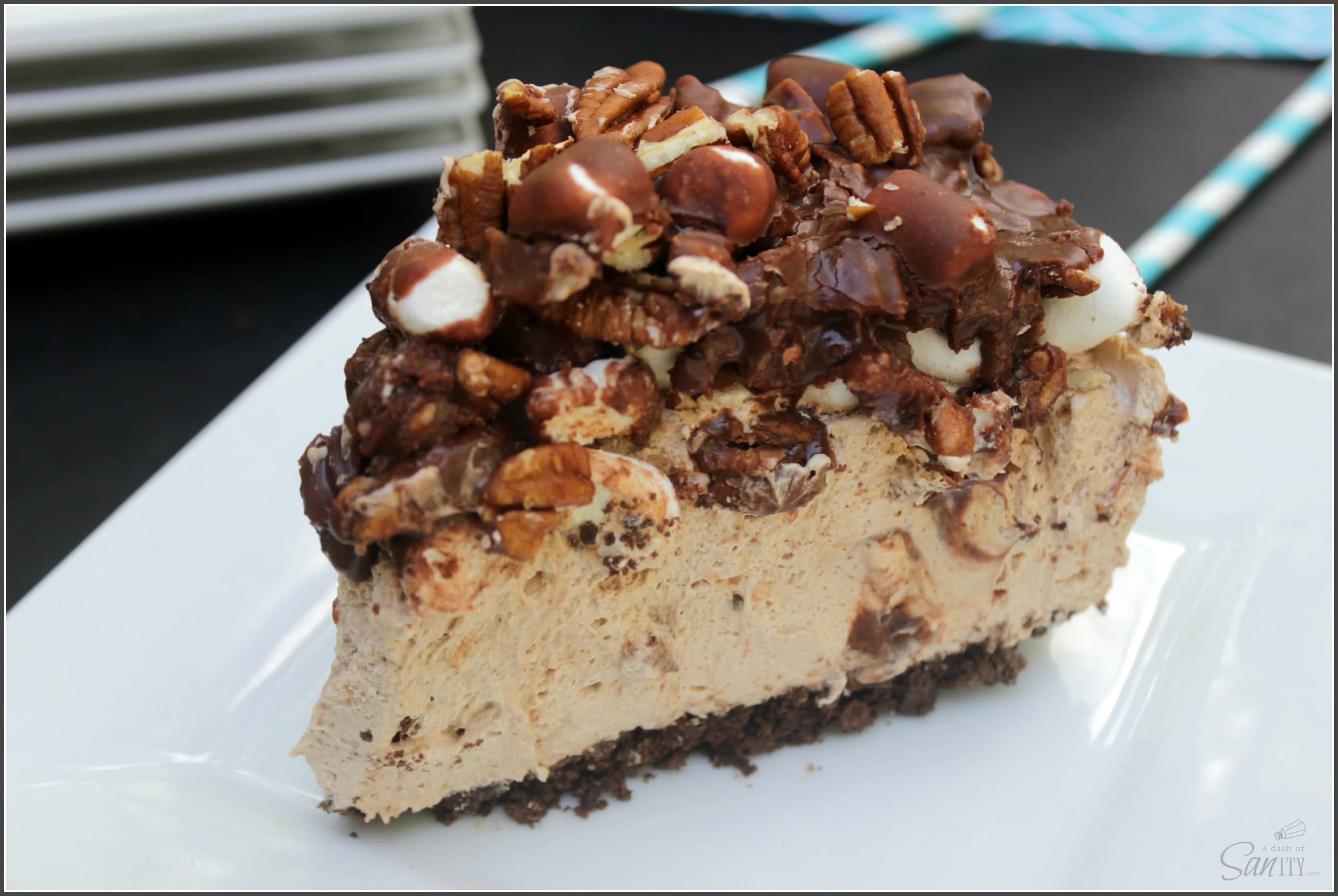 Mississippi Mud Pie No Bake Cheesecake is a fluffy milk chocolate cheesecake, with a chocolate crust, & topped with a marshmallow pecan fudge frosting.