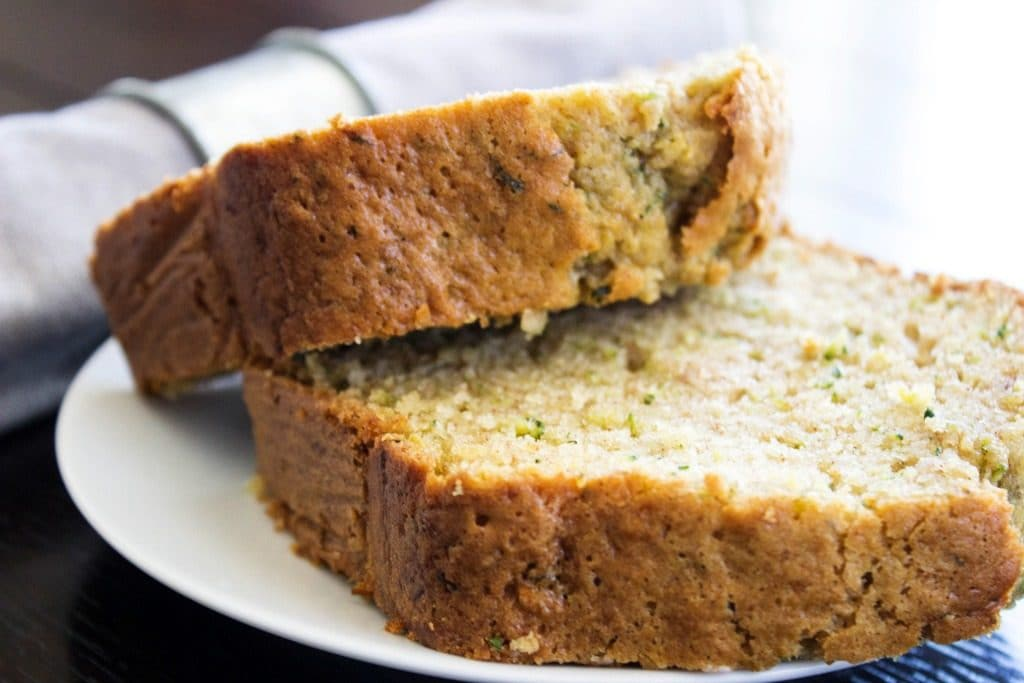 zucchini bread slices on a white plate