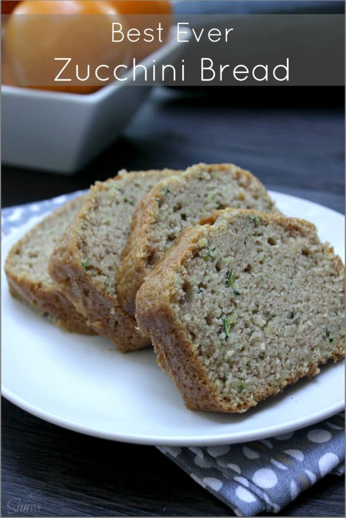 BEST EVER ZUCCHINI BREAD four slices on a white plate