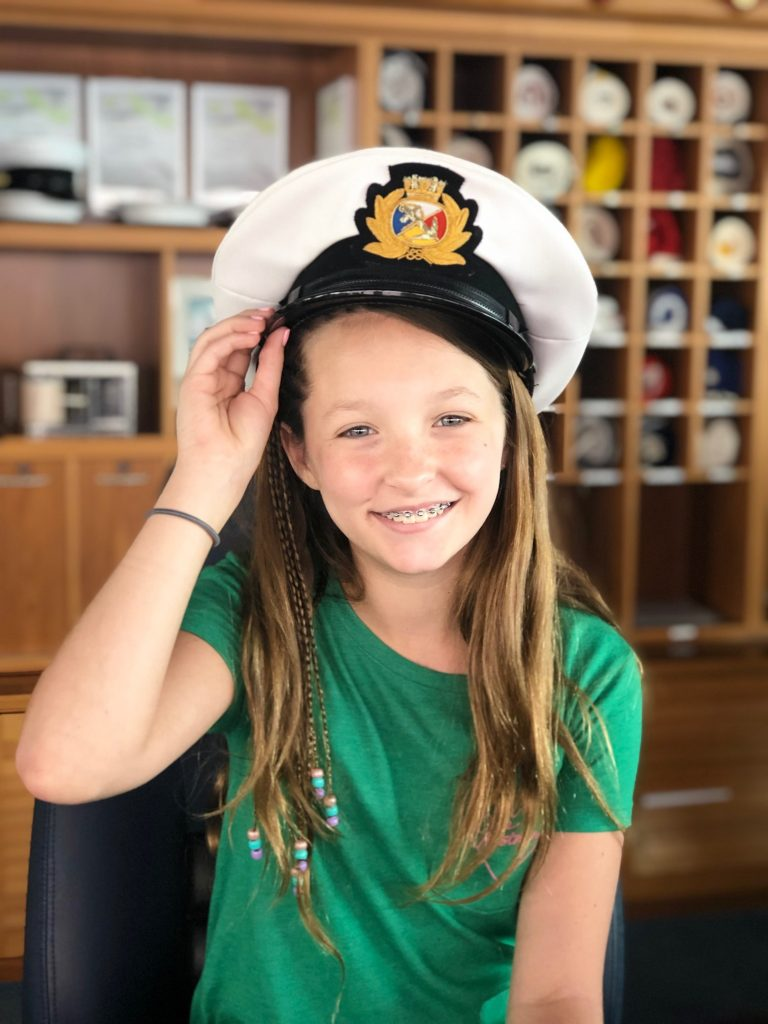 photo of jordan with ship captain's hat on