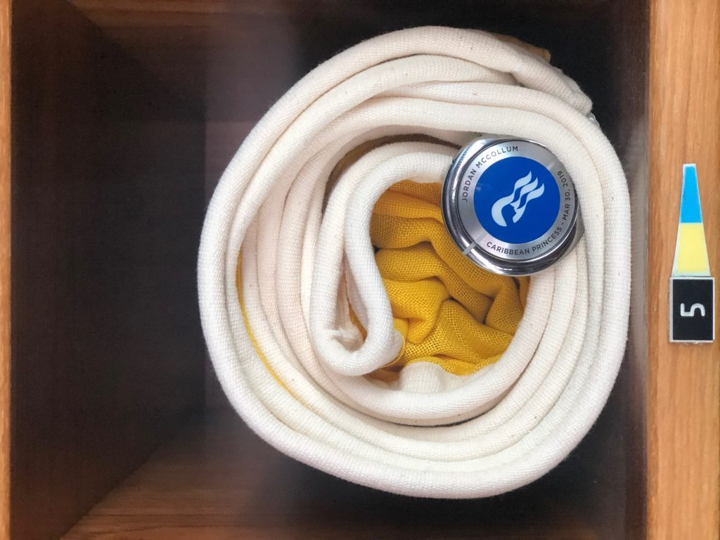 photo of blanket rolled up on cruise ship