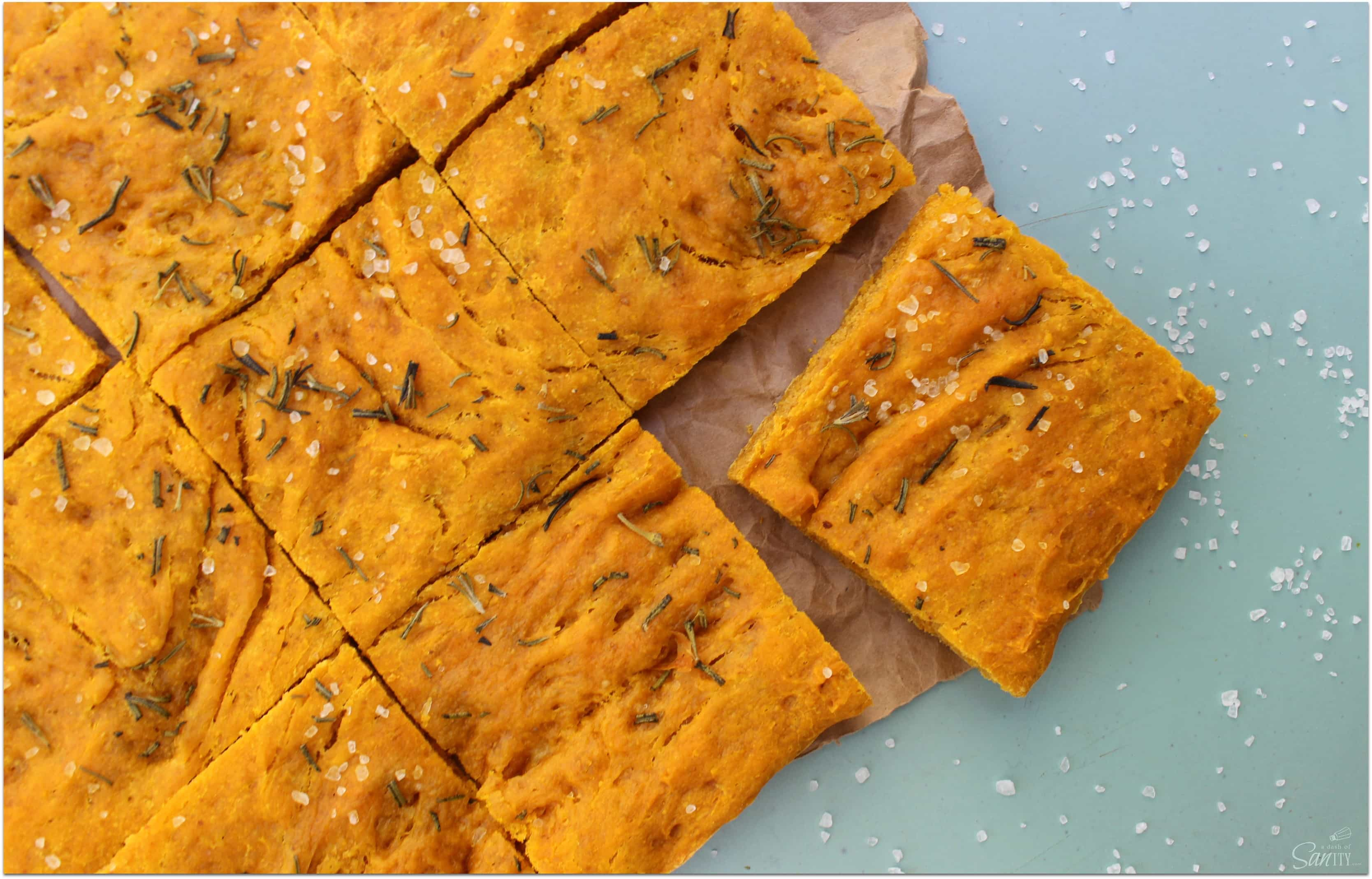 This Pumpkin Focaccia Bread is a savory fall inspired bread made with fresh pumpkin and rosemary. It is an easy to make addition to your holiday spread.