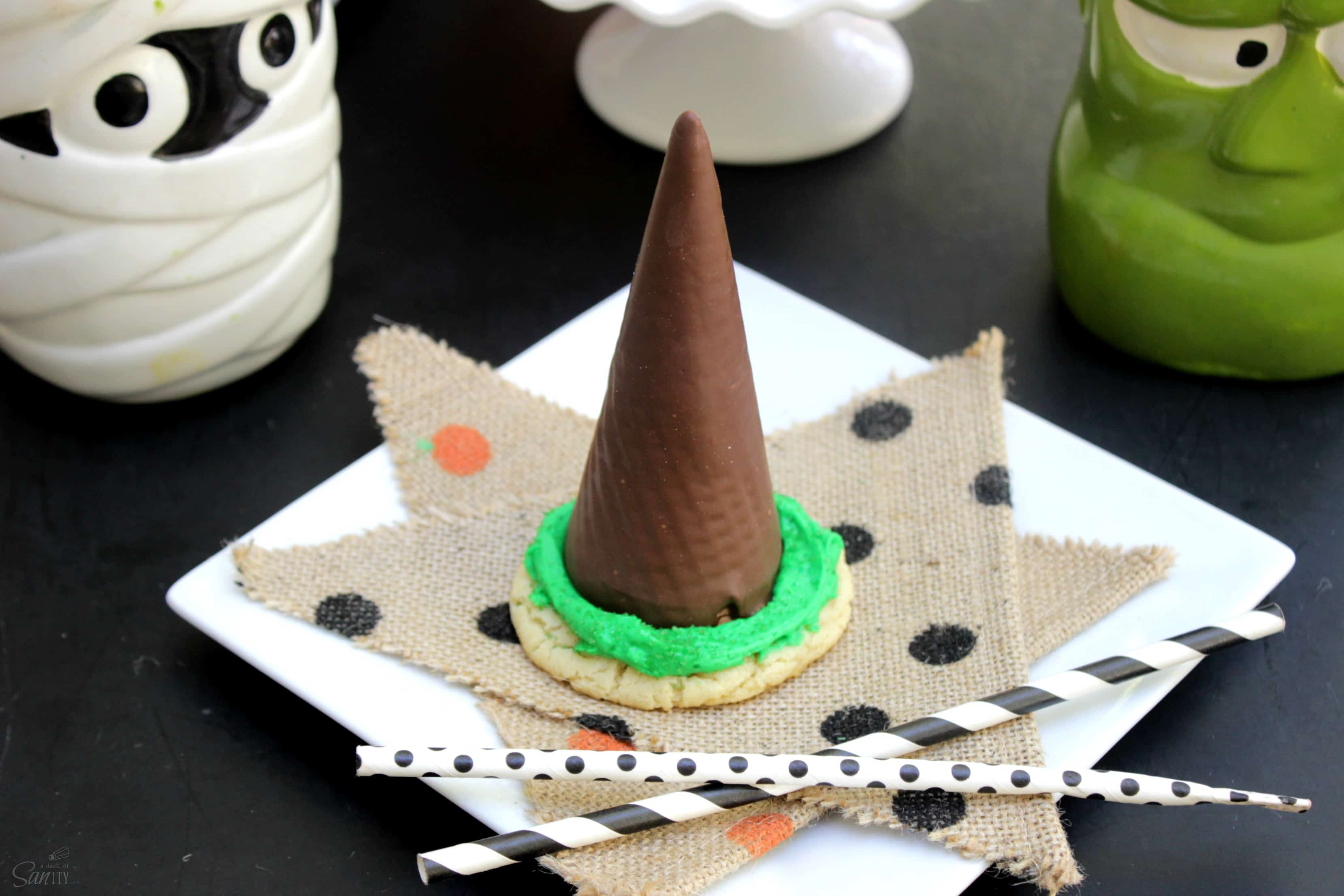 "Transform your Halloween party into a ""witchy"" celebration with these delicious and cute Witch Hat Sugar Cookies. They are so easy and fun to make!"