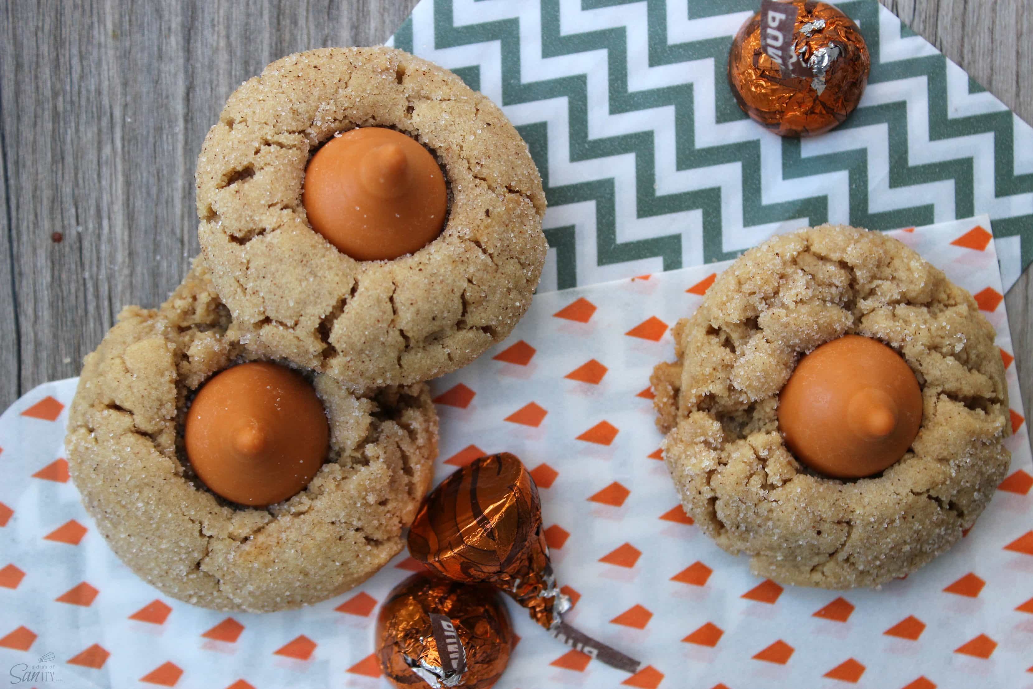 These Pumpkin Spice Peanut Butter Blossoms are a pumpkin-spice peanut butter cookie topped with a Pumpkin Spice Hershey Kiss. They are a perfect fall treat.