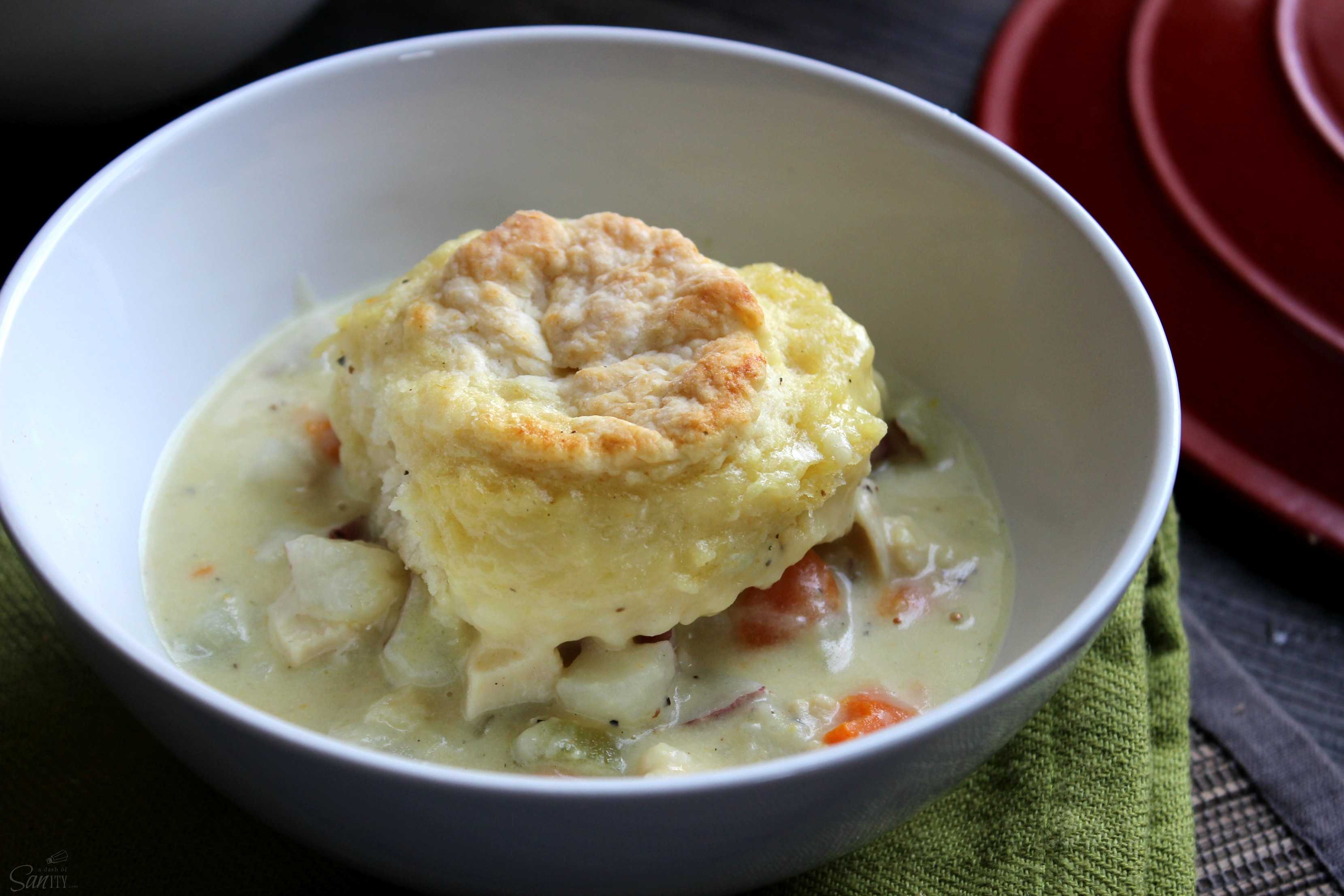 This One Pot Chicken & Biscuits is a simple and delicious recipe with biscuits made from scratch. A fantastic classic comfort food brought to you in bowl.