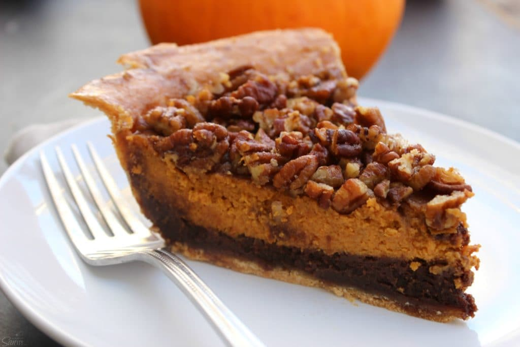"""Chocolate Pecan Pumpkin Pie rich chocolate """"brownie like"""" bottom, classic pumpkin pie and topped with pecans all baked into onedeliciouspie."""