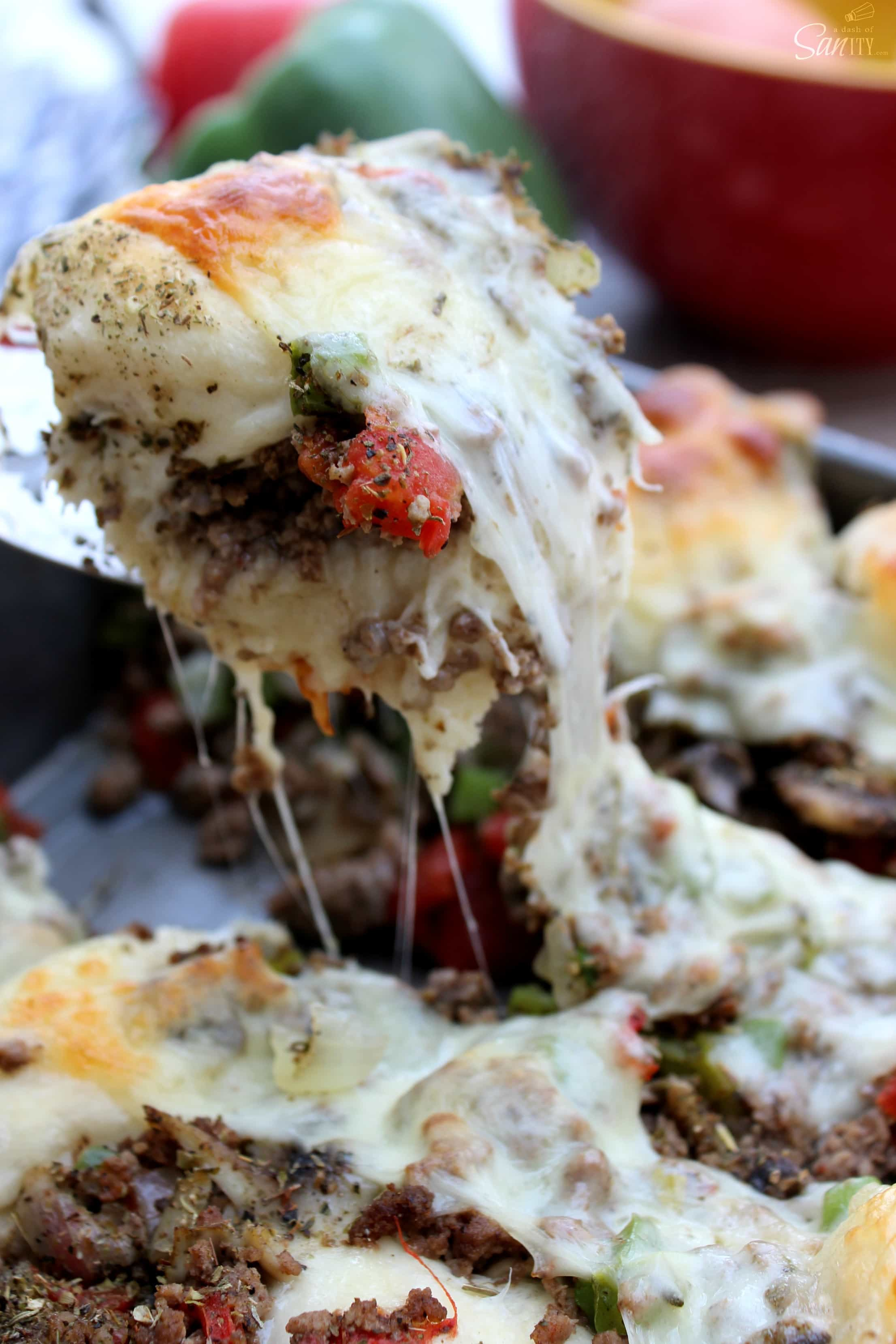 These Cheesy Pull Apart Italian Subs are so easy and delicious! Made with all the delicious toppings that are found in a traditional Italian Sub.