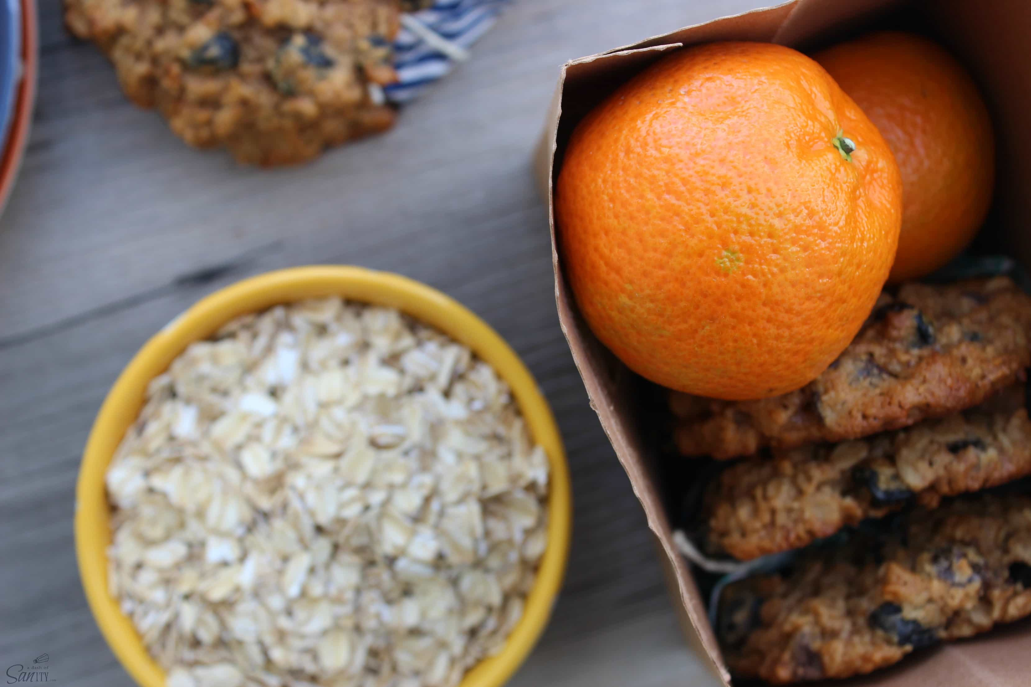 a bowl of oats with an orange