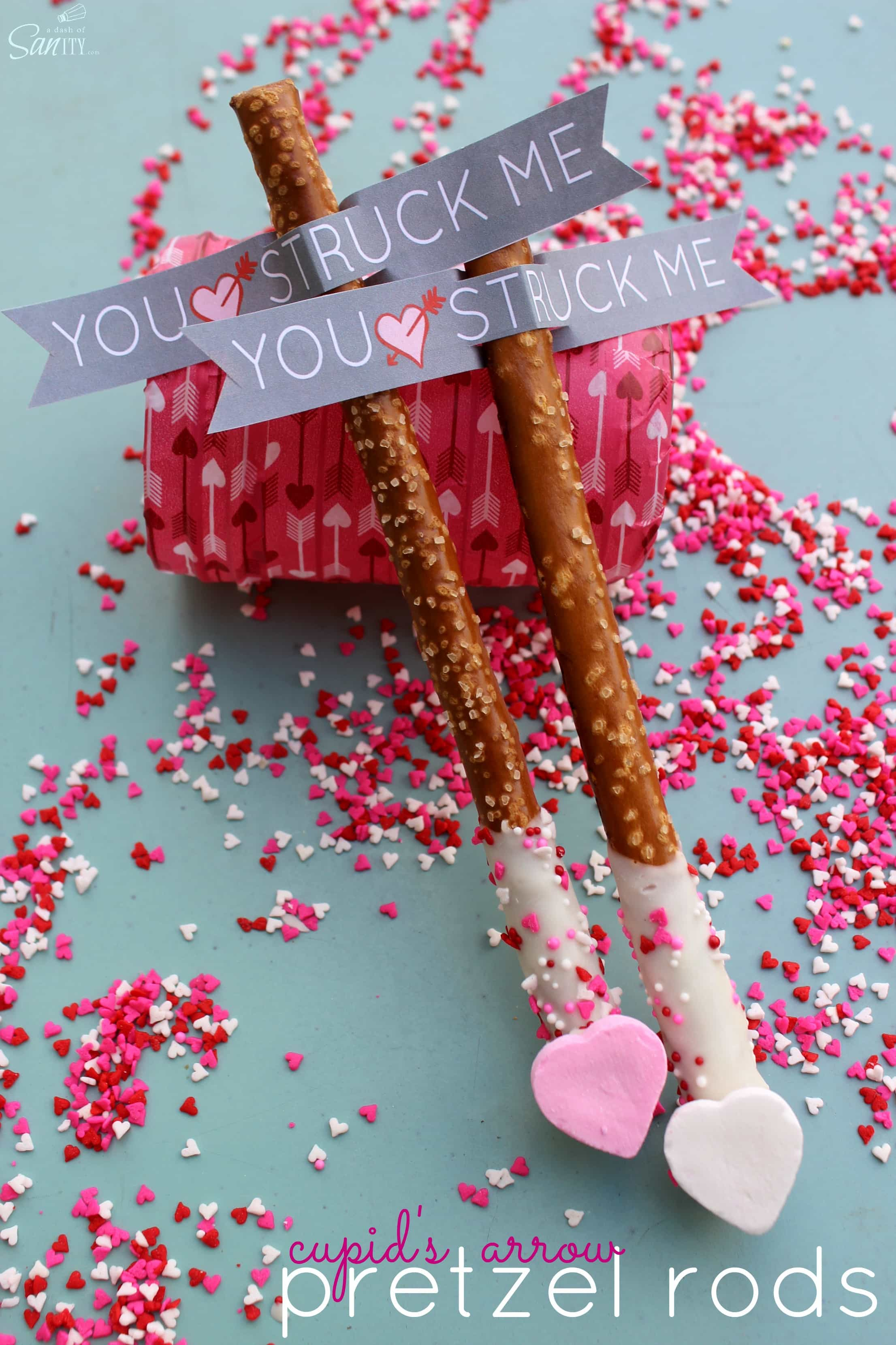 Cupid's Arrow Pretzel Rods are a fun and festive Valentine's Day treat. Using Vanilla CandiQuik and conversation candy hearts, these are easy to prepare.