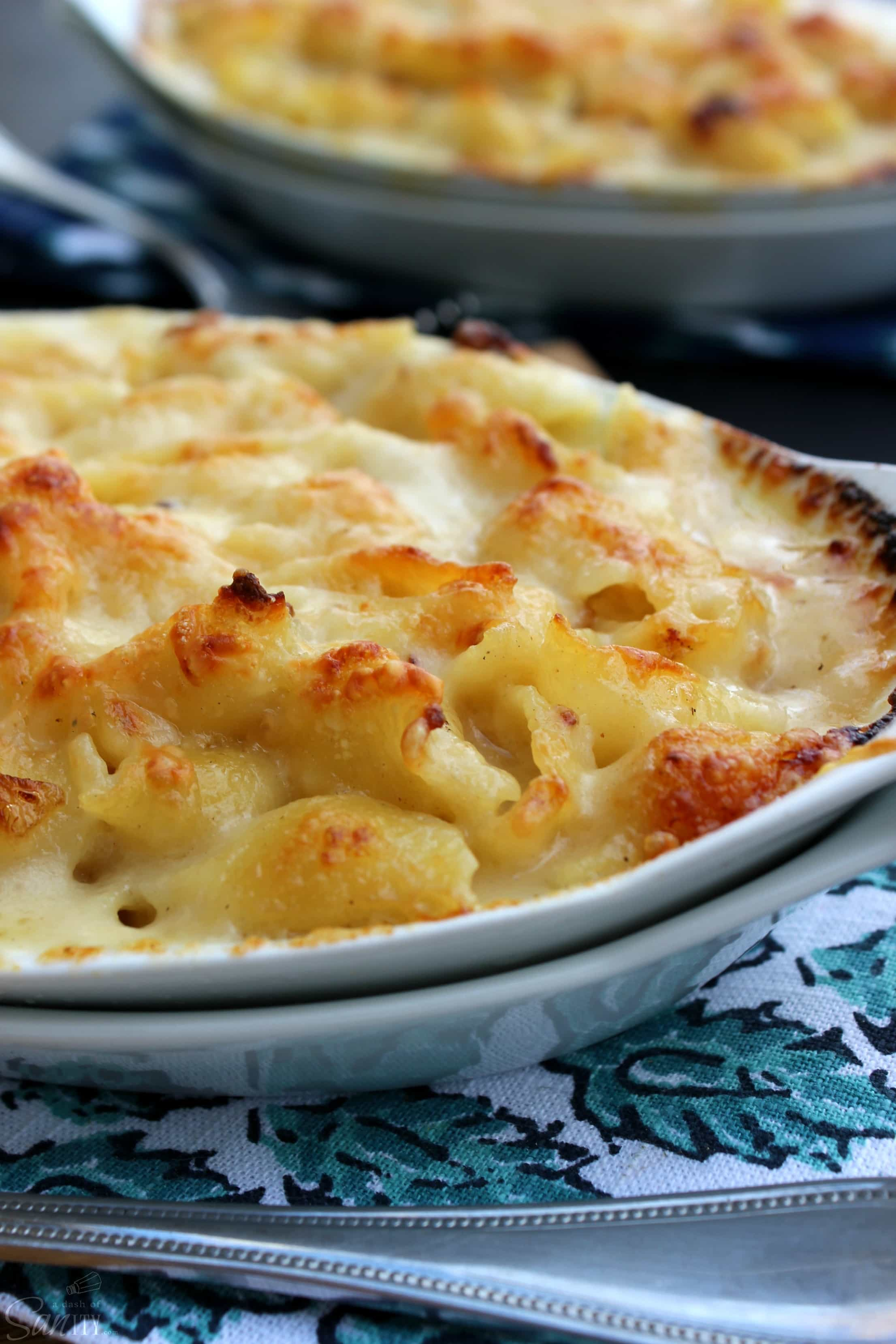 Scalloped Mac & Cheese is a creamy, rich, and delish pasta dish that is easy to make & ready in less than 45-minutes. Time to move over Scalloped Potatoes.