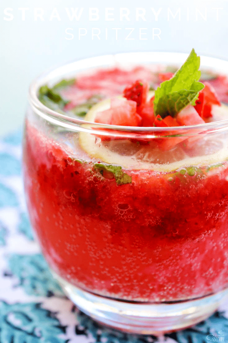 photo of Strawberry Mint Spritzer in a short glass with strawberry and mint leave garnish