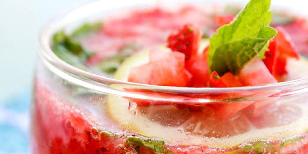 up close of garnish on top of Strawberry Mint Spritzer in a glass