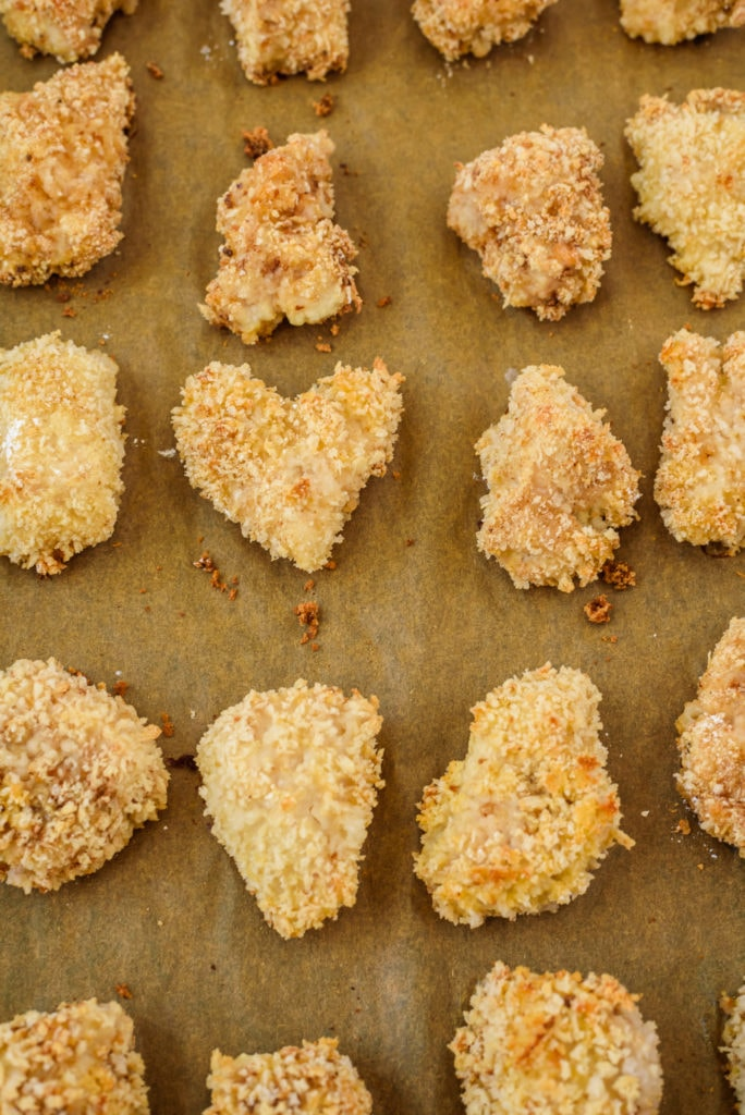 photo of crispy baked chicken pieces on a baking sheet