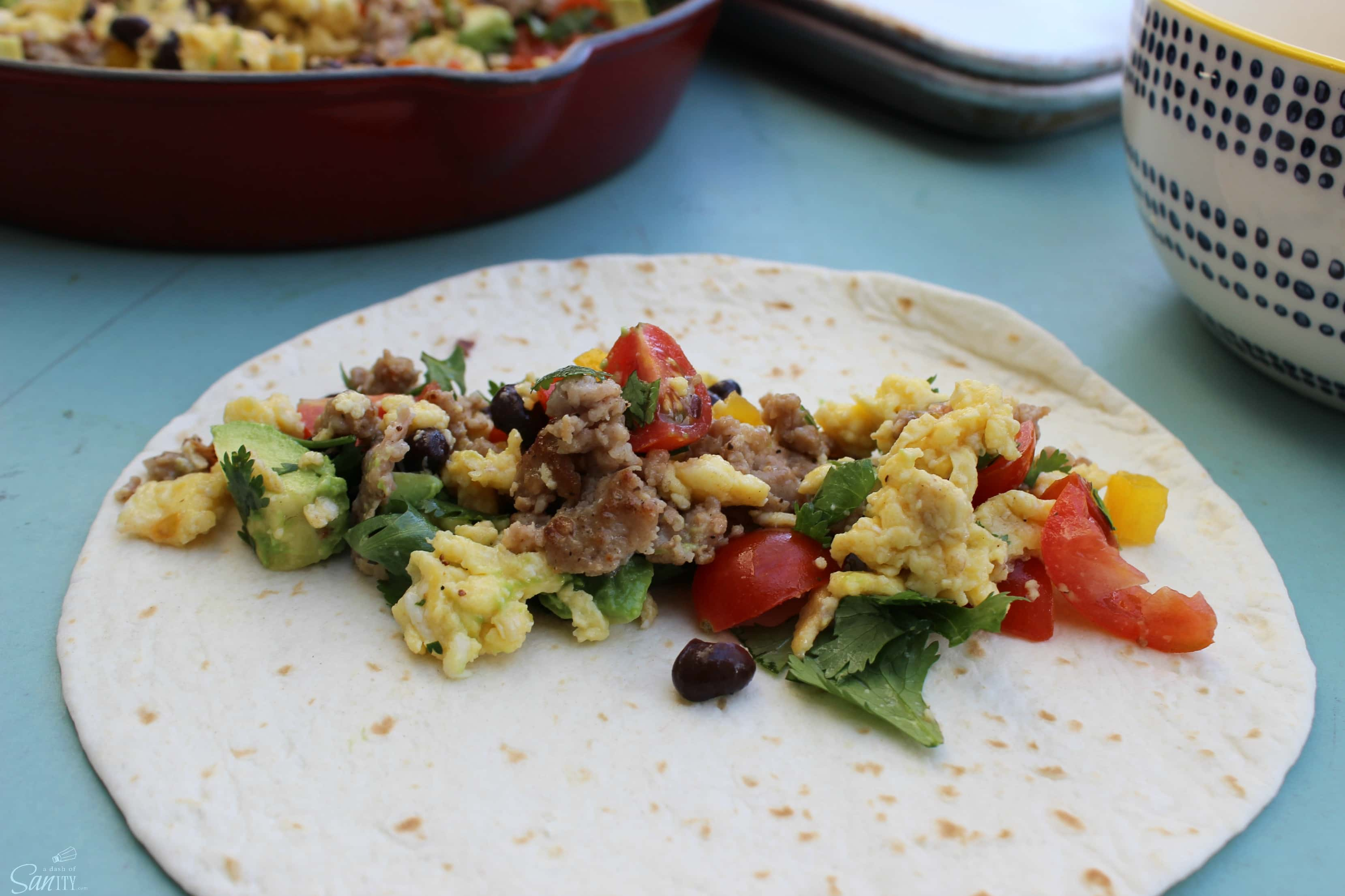 These Santa Fe Breakfast Taquitos are loaded with eggs, breakfast sausage, fresh peppers, tomatoes, cilantro, & jalapeno for those who like a little heat.