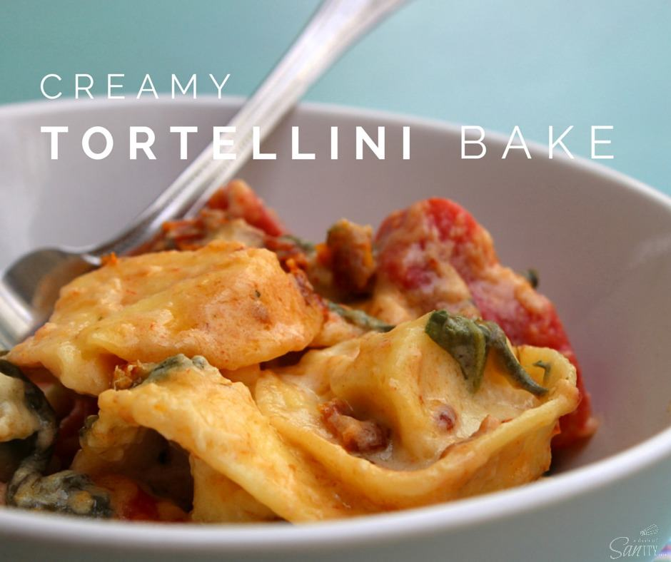This easy to make Creamy Tortellini Bake is made with five-cheese tortellini, spinach, and light Alfredo sauce with a hint of bacon and sun-dried tomatoes.
