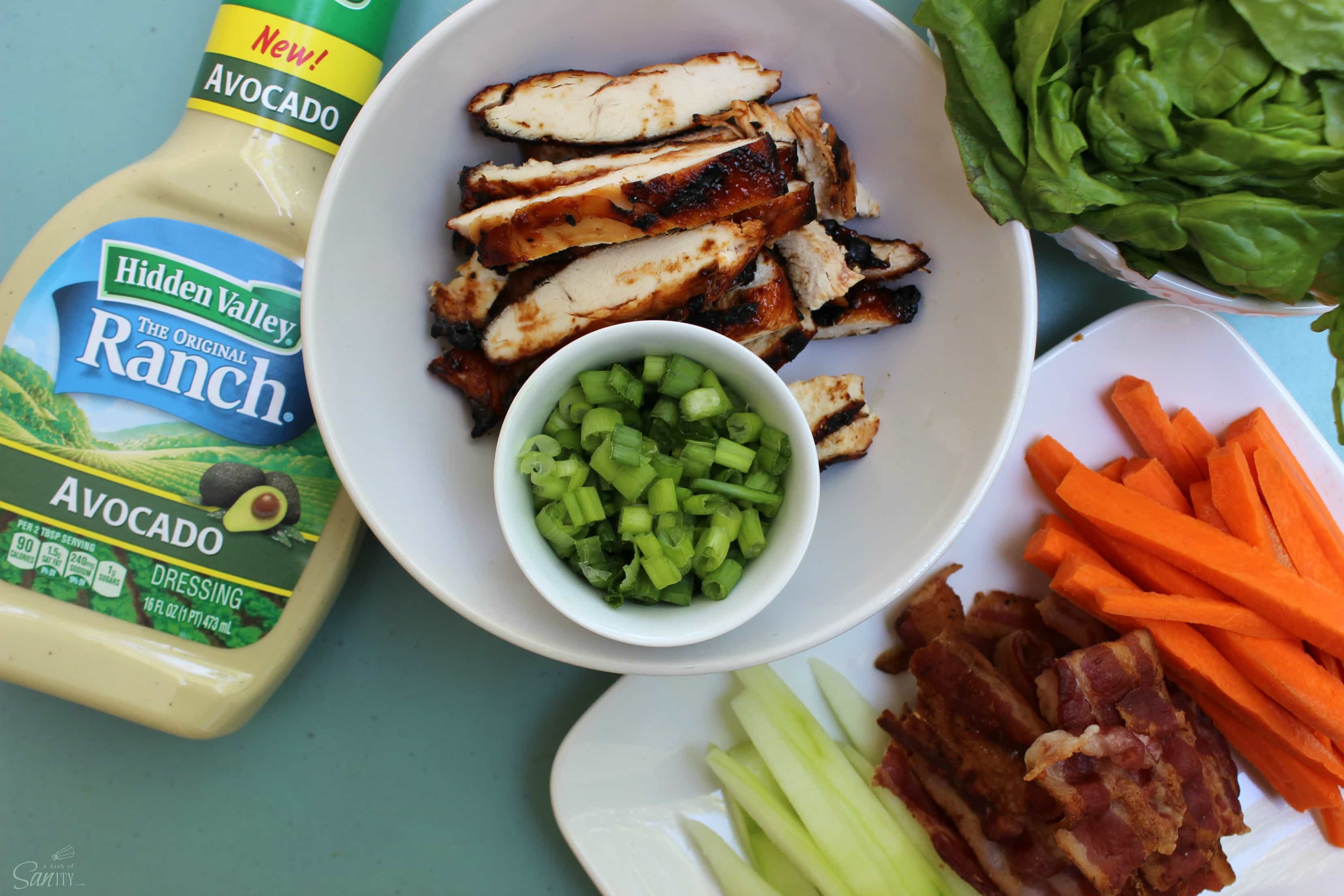 Barbecue Chicken Spring Rolls are full of flavor with fresh vegetables, barbecue chicken, bacon, Avocado Ranch dressing, and a drizzle of barbecue sauce.