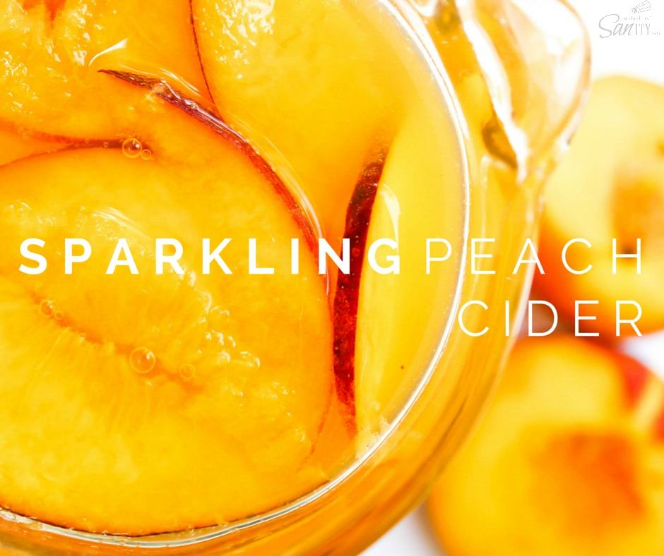 This Sparkling Peach Cider is a gorgeous summer drink to toast to late summer nights, days at the pool, and time spent with family & friend.