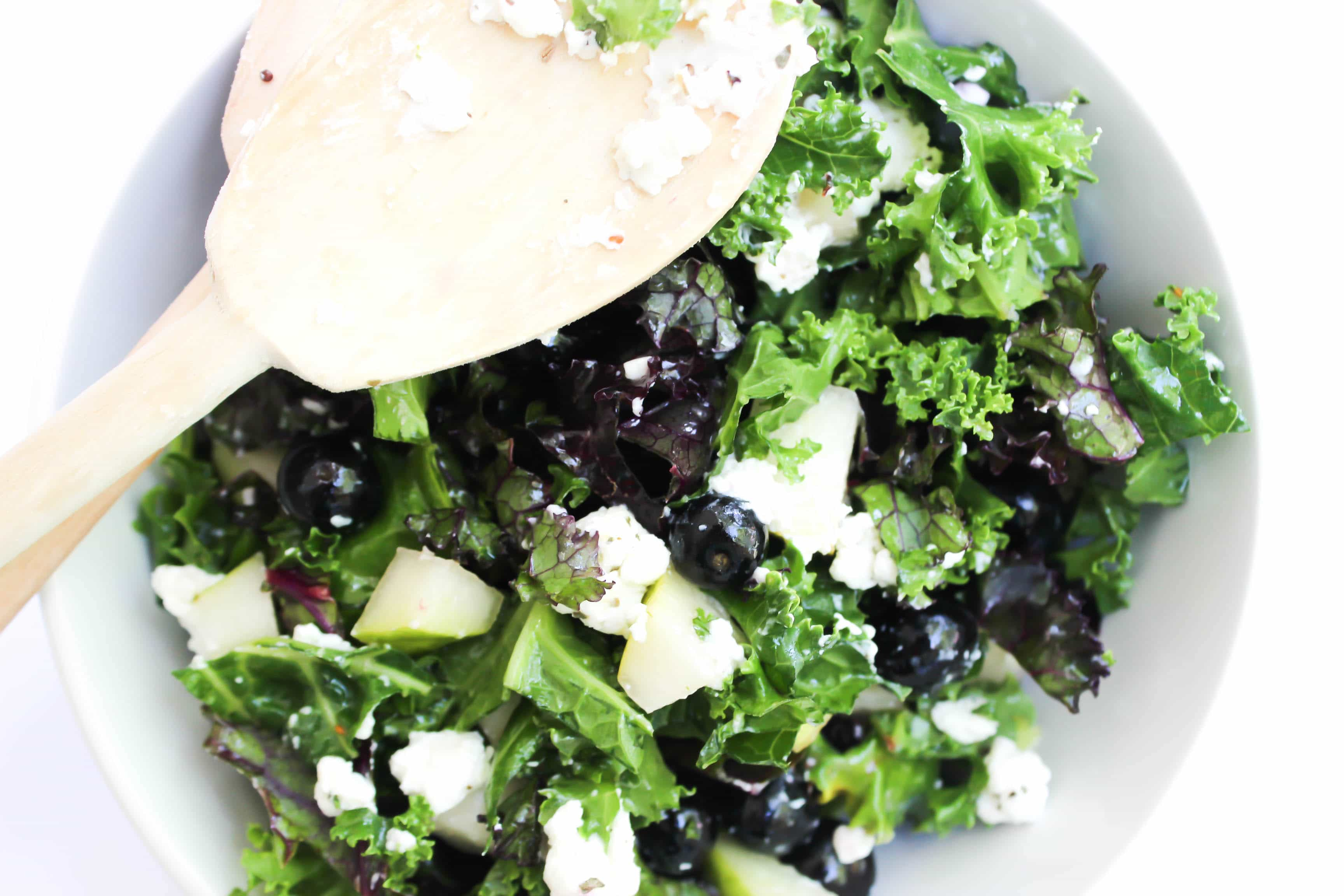 This healthy Power Kale Salad is made with two different kinds of kale, blueberries, pears, goat cheese, and pecans, drenched in a sweet lemon dressing.