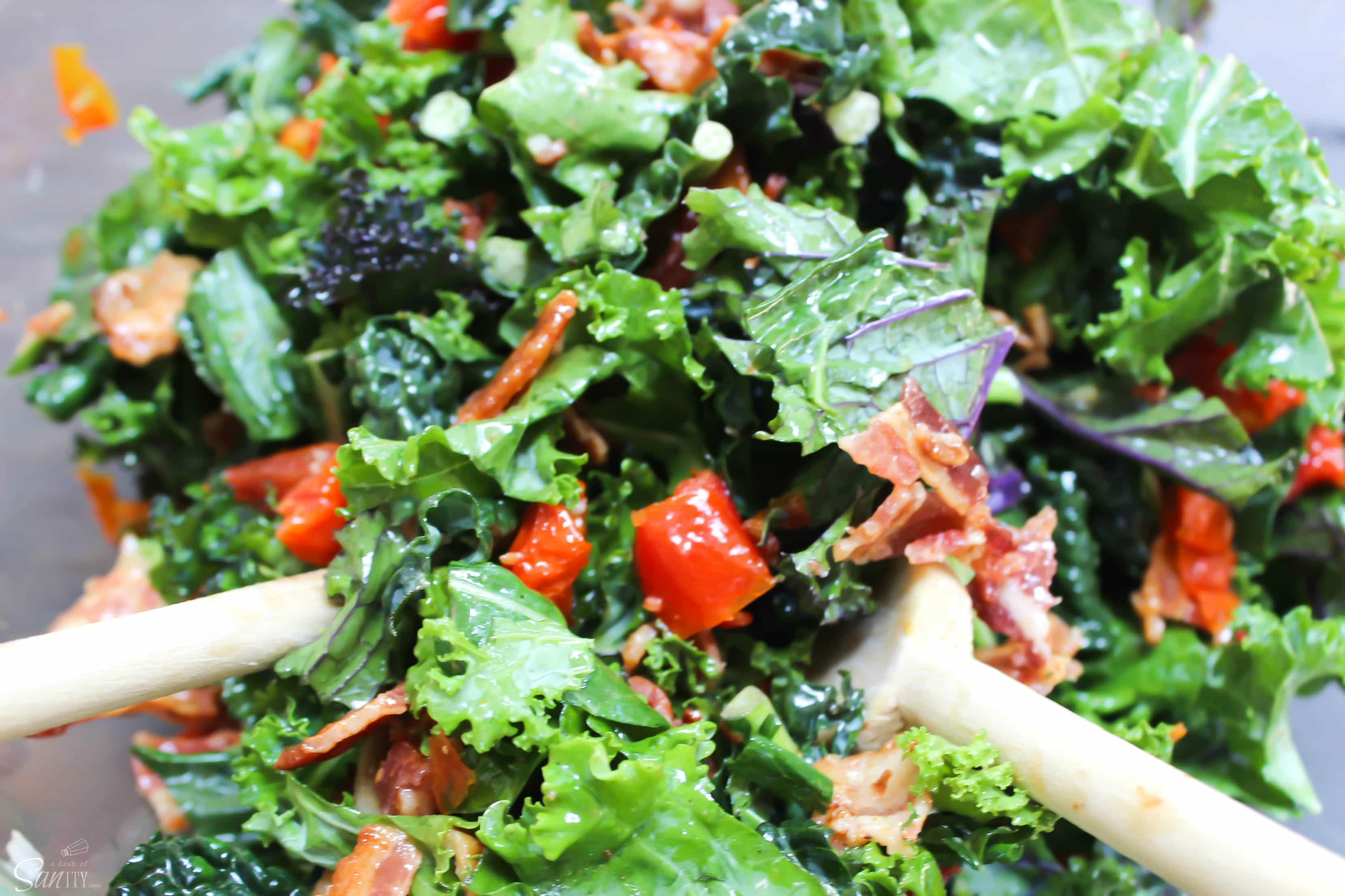 "This ""BLT"" Kale Salad"" has large chunks of bacon, kale,& roasted tomatoes with a lemon garlic dressing. This salad takes the term BLT to a whole new level."