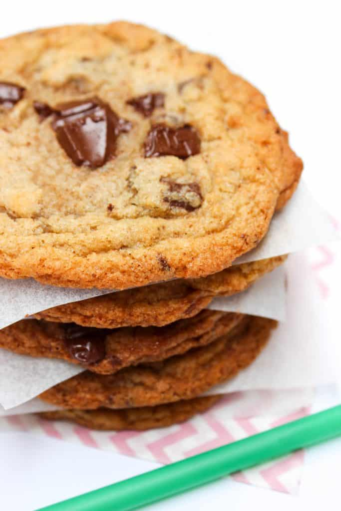 stack of Copycat Starbucks Chocolate Chip Cookies separated by parchment squares
