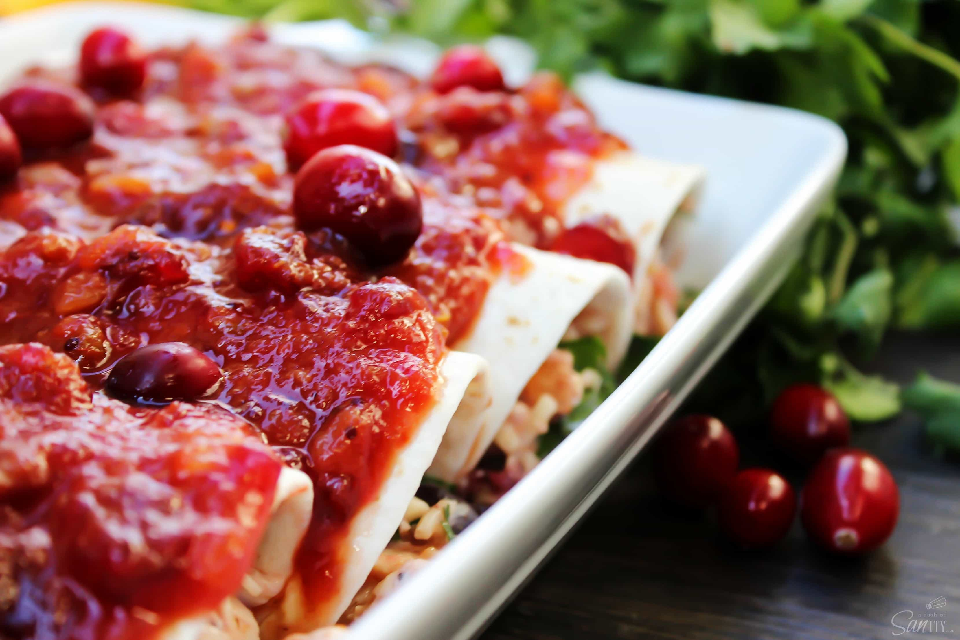 Made with a tangy-sweet sauce these Cran-Turkey Enchiladas are the best twist on enchiladas that I have ever had. Don't wait for the holidays to make these!