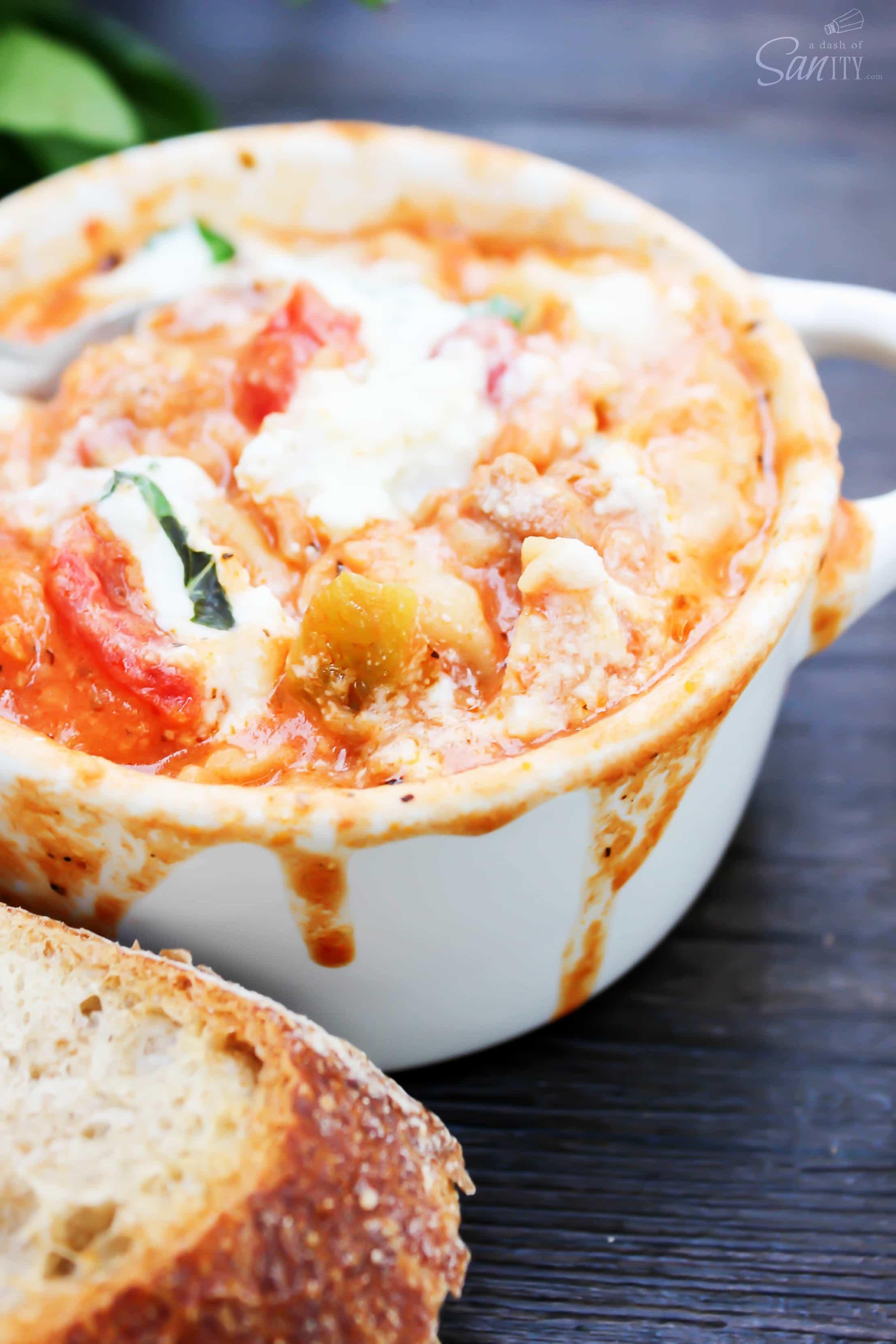 This Slow Cooker Lasagna Soup is comfort food at its best. Let it simmer all day while it fills up the house with the aroma of tomatoes and basil.