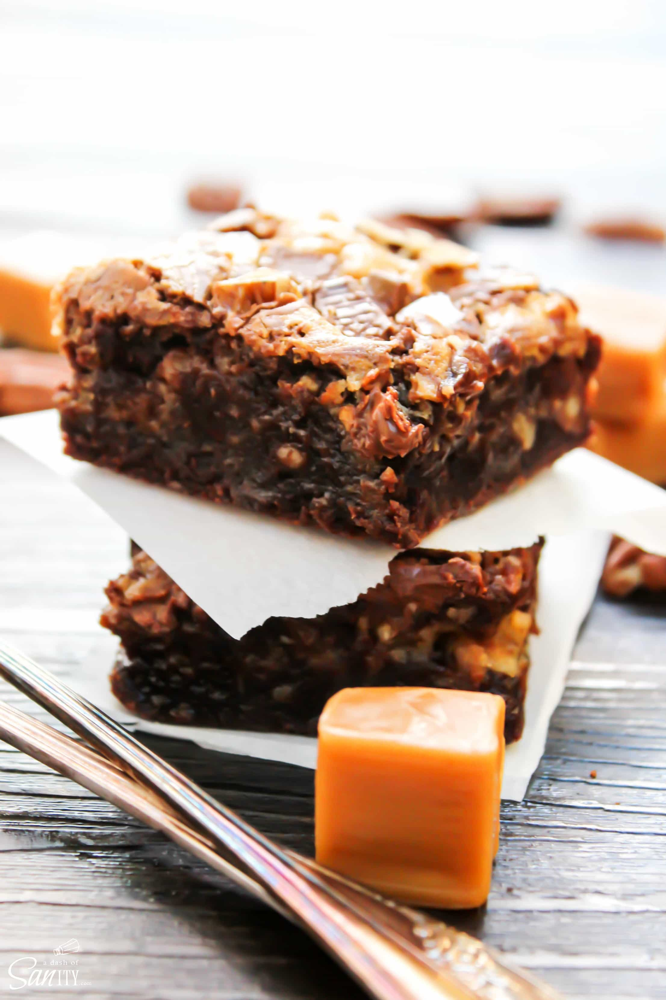 Turtle Cheesecake Fudge Brownies are rich fudge brownies with a caramel cheesecake swirl, topped with chopped pecans. #Spreadcheer with this decadent treat.