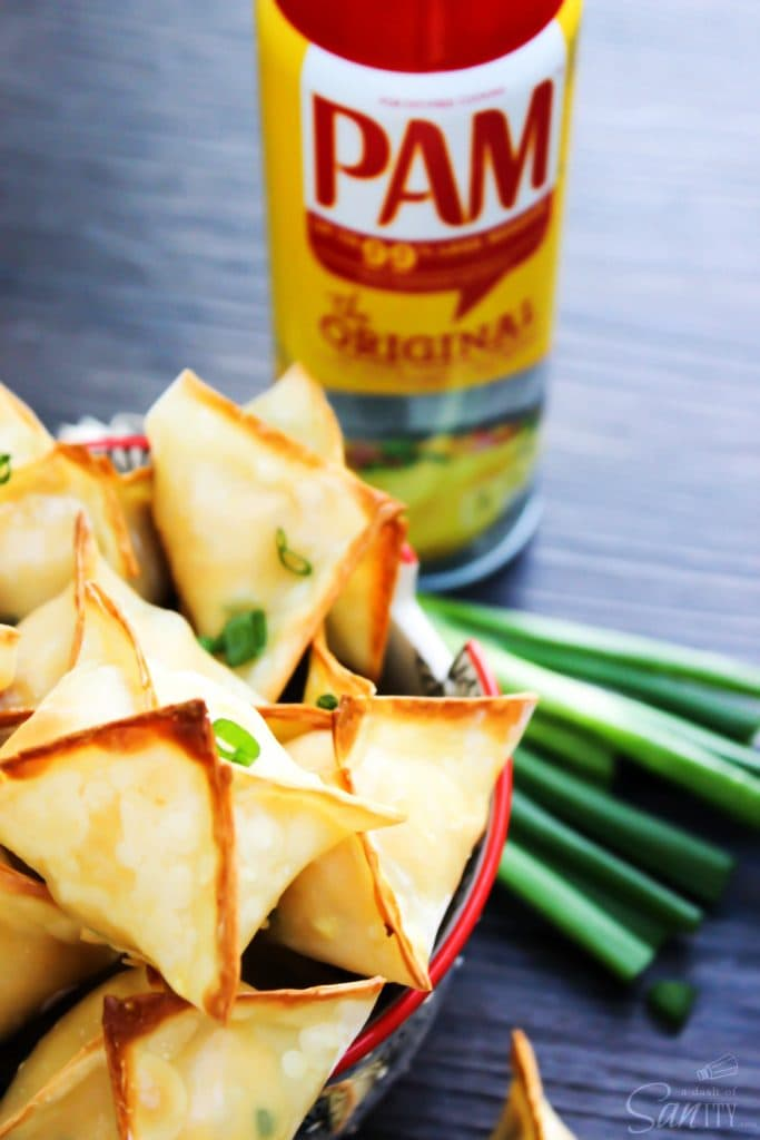 Baked Chicken Wontons are a healthier version of the classic cream-cheese wonton, with a chicken filling flavored with sesame, green onions and sriracha.
