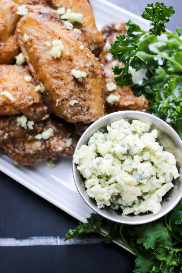 Black and Blue Chicken Wings are tossed in a blue cheese vinaigrette, pepper, three kinds of garlic, & crumbled blue cheese. This isn't a wing for the weak.