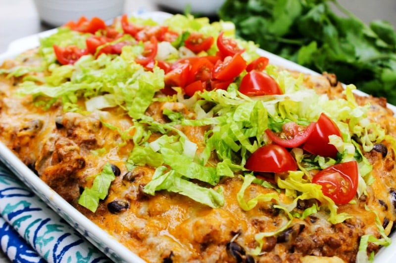 Easy Beef Enchilada Bake is a delicious, easy to make twist on classic enchiladas. This 30-minute meal will be one that the whole family loves.