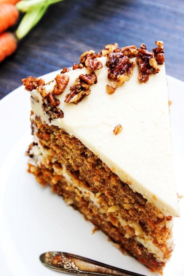 Carrot Cake with Maple Brown Sugar Buttercream & Candied Pecans with coconut, maple syrup, brown sugar, and pecans make a combo that will have you swooning.