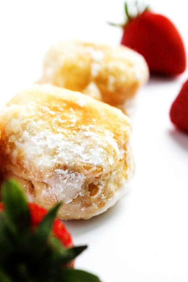 Strawberries & Cream Beignets is a classic dessert made with simple cream and beignets that are so easy to make. Strawberry season has never tasted so good.