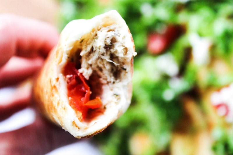 Slow Cooker Greek Chicken Taquitos is a twist on classic chicken taquitos. Made with fresh tomatoes, feta, and Greek dressing, this is so easy & delicious.