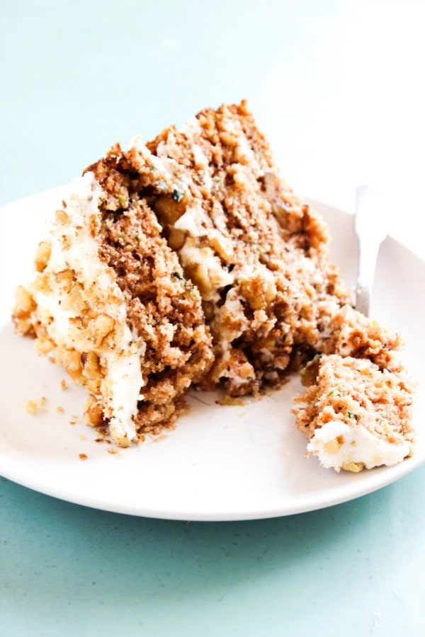 Banana Zucchini Cake slice on a plate with a fork with a bite on it